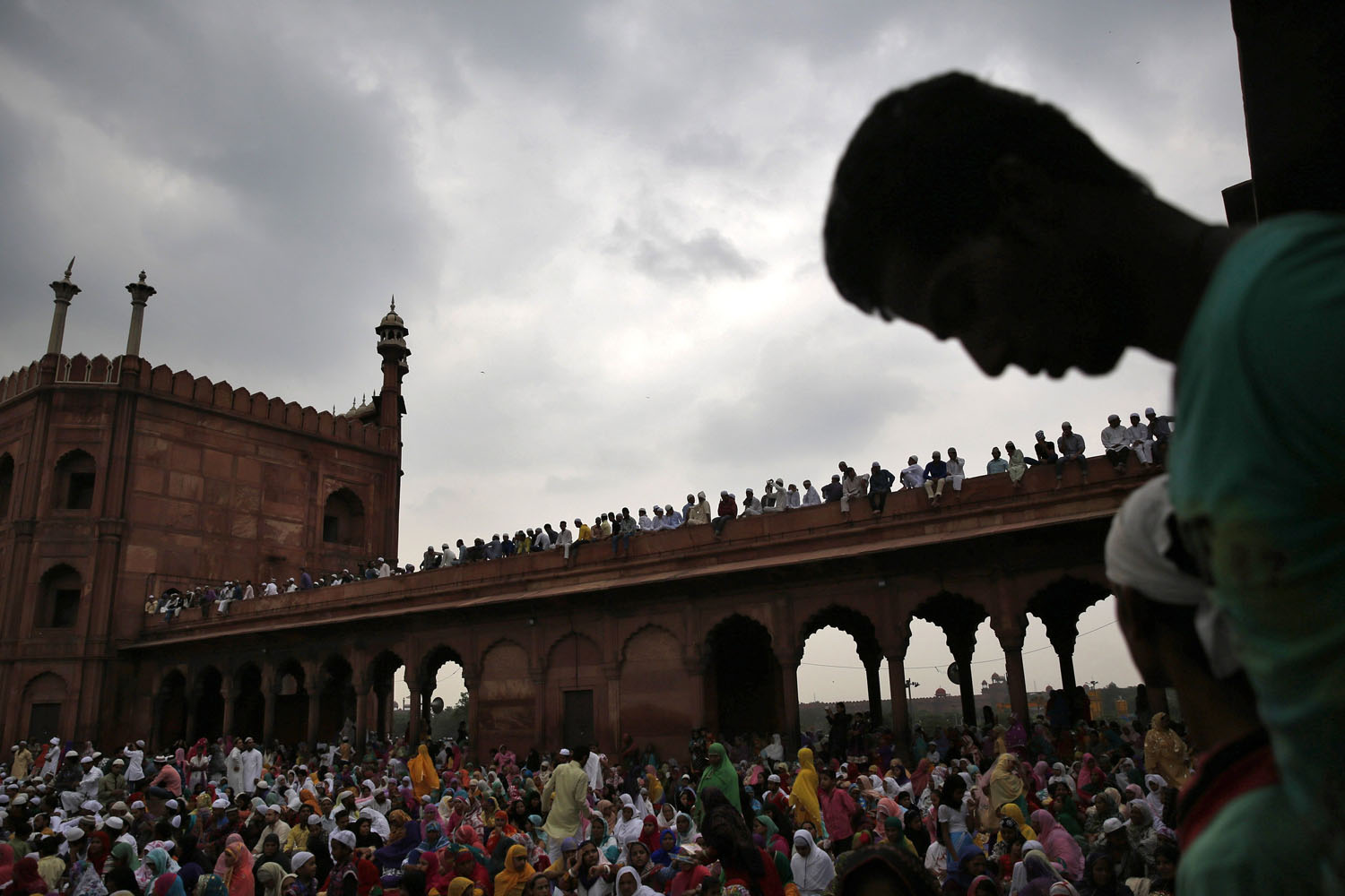 Jul. 25, 2014.Muslims sit inside the compound of Jama Masjid (Grand Mosque) before the start of last Friday prayers of the holy fasting month of Ramadan in the old quarters of Delhi.
