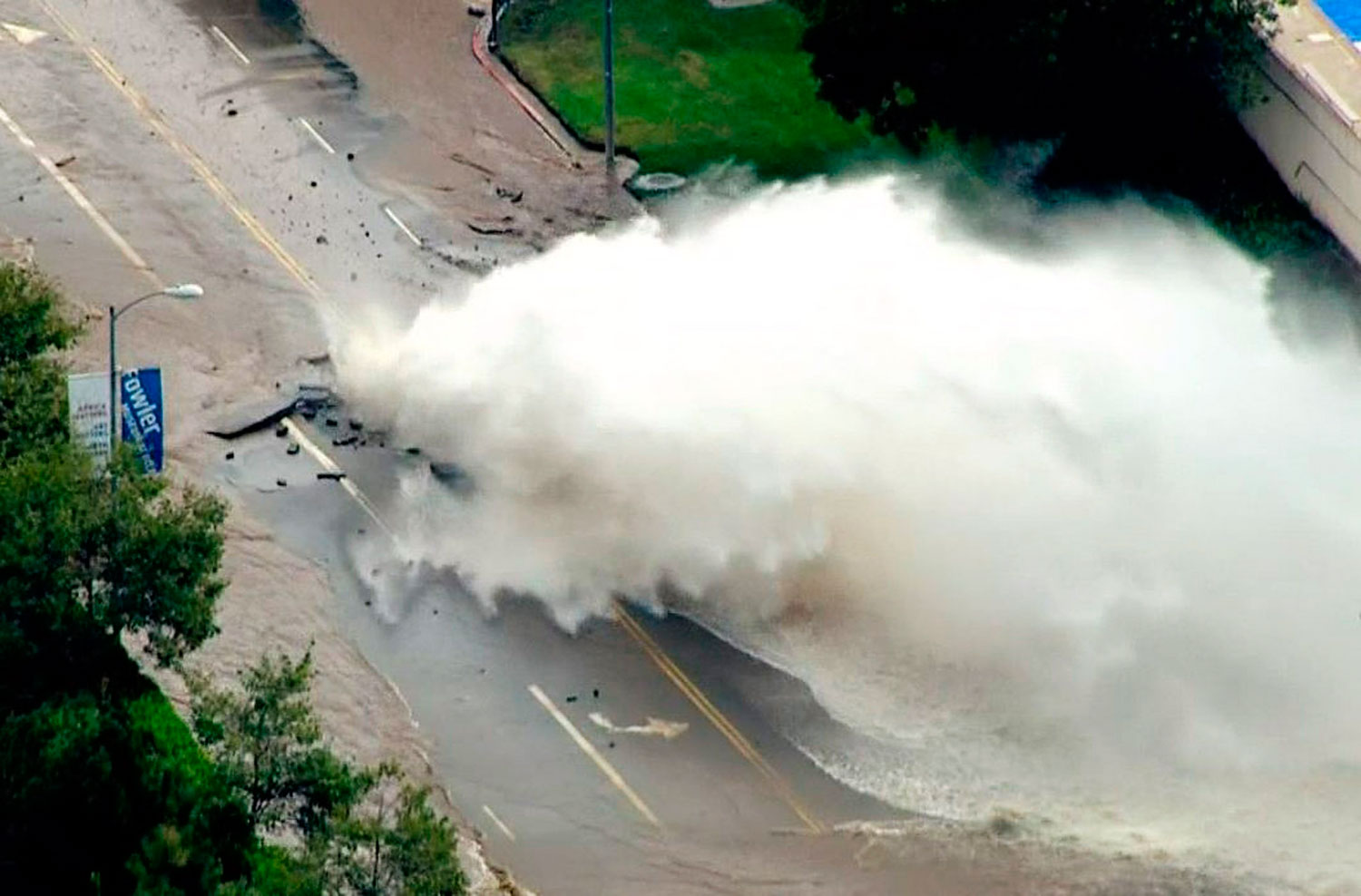 Water gushes from a broken water main on Sunset Boulevard on the UCLA campus in Los Angeles July 29, 2014 in this still image from aerial video from NBCLA.com.