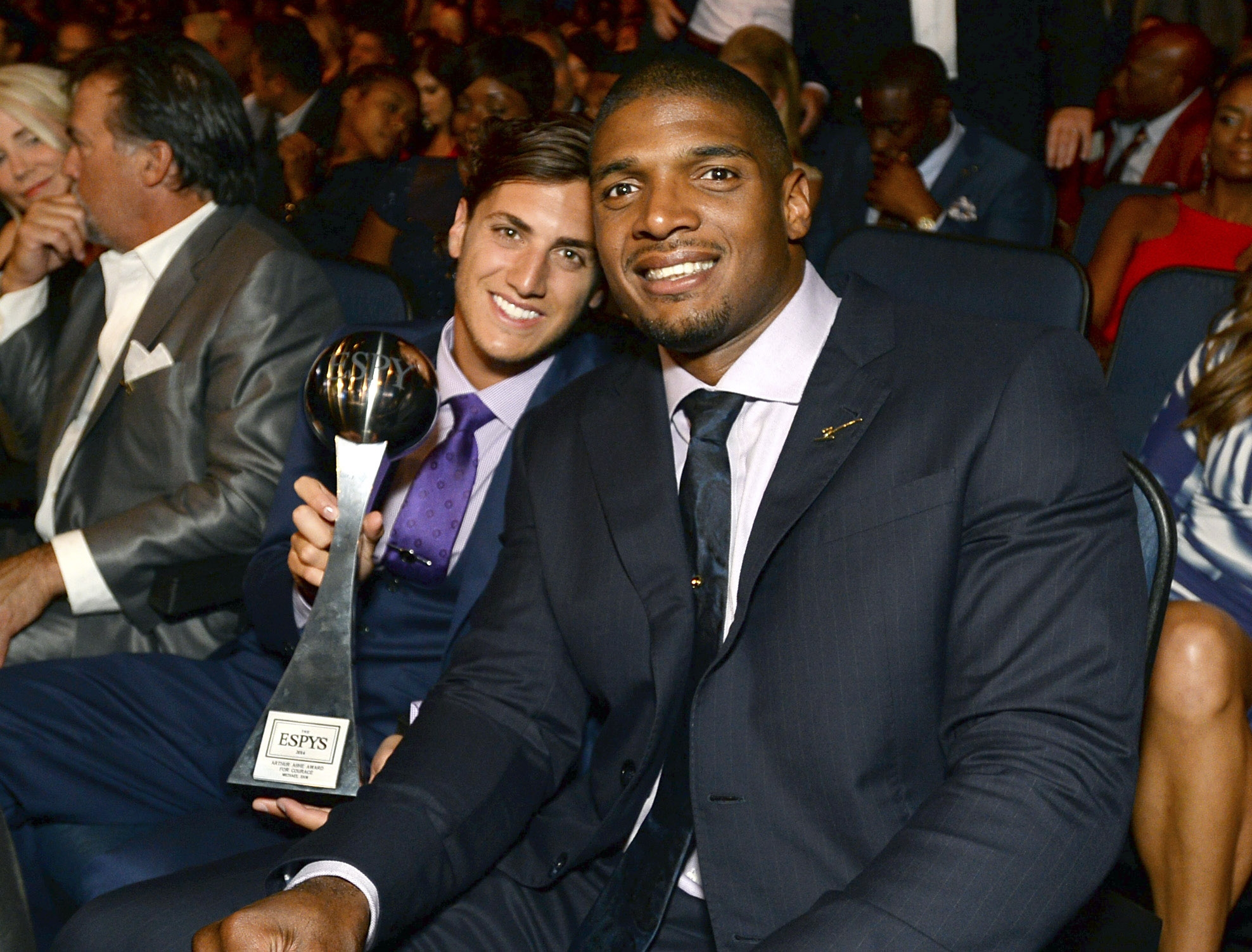 Vito Cammisano, left, and Michael Sam pose in the audience at the ESPY Awards at the Nokia Theatre on Wednesday in Los Angeles.