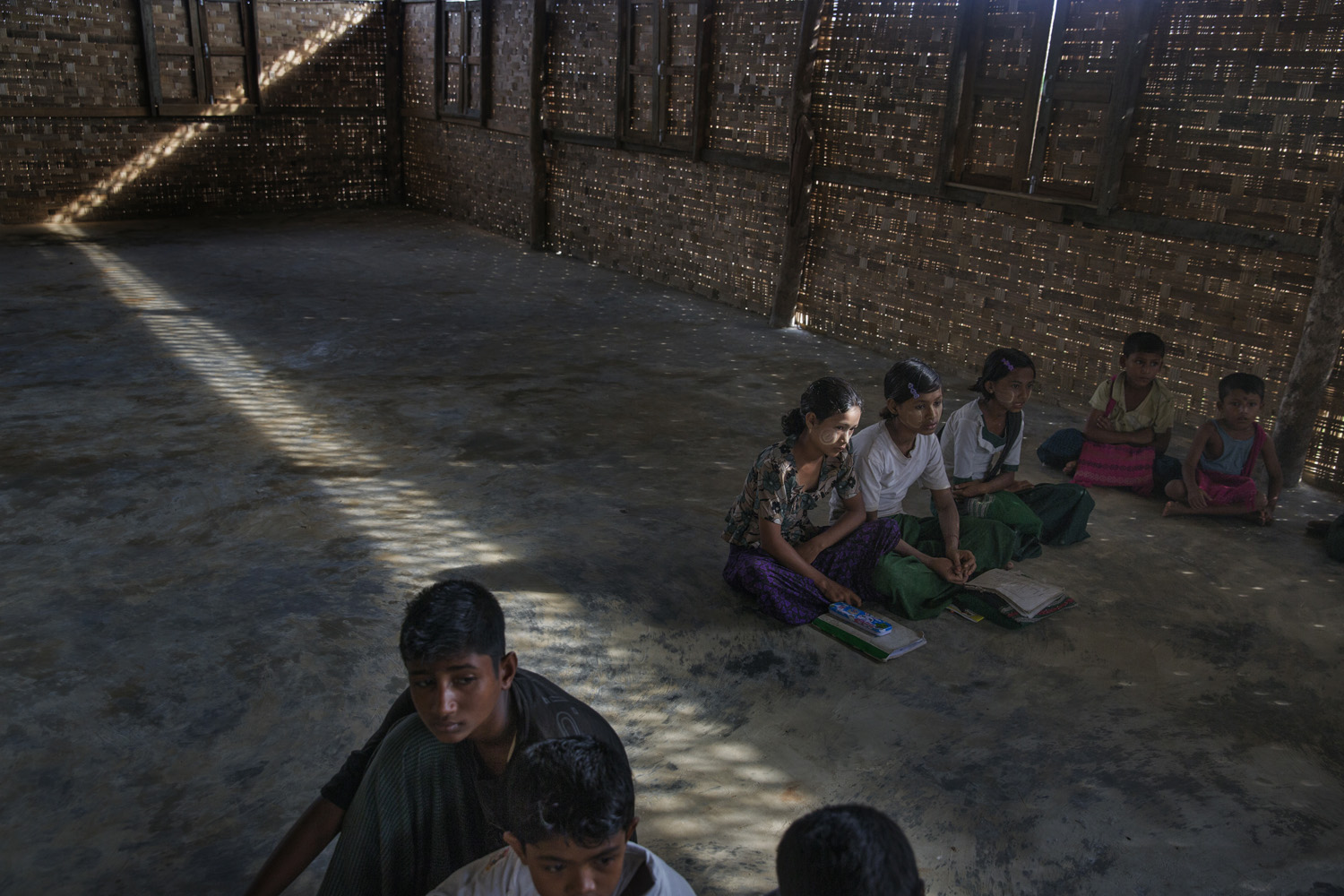Children learning the Quran at a madrassa in one of the camps.