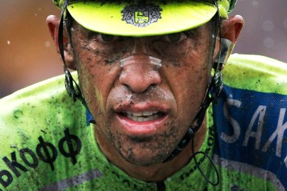 Spain's Alberto Contador crosses the finish line with a delay of more than two minutes on his main rivals during the fifth stage of the Tour de France cycling in Arenberg, France on July 9, 2014.