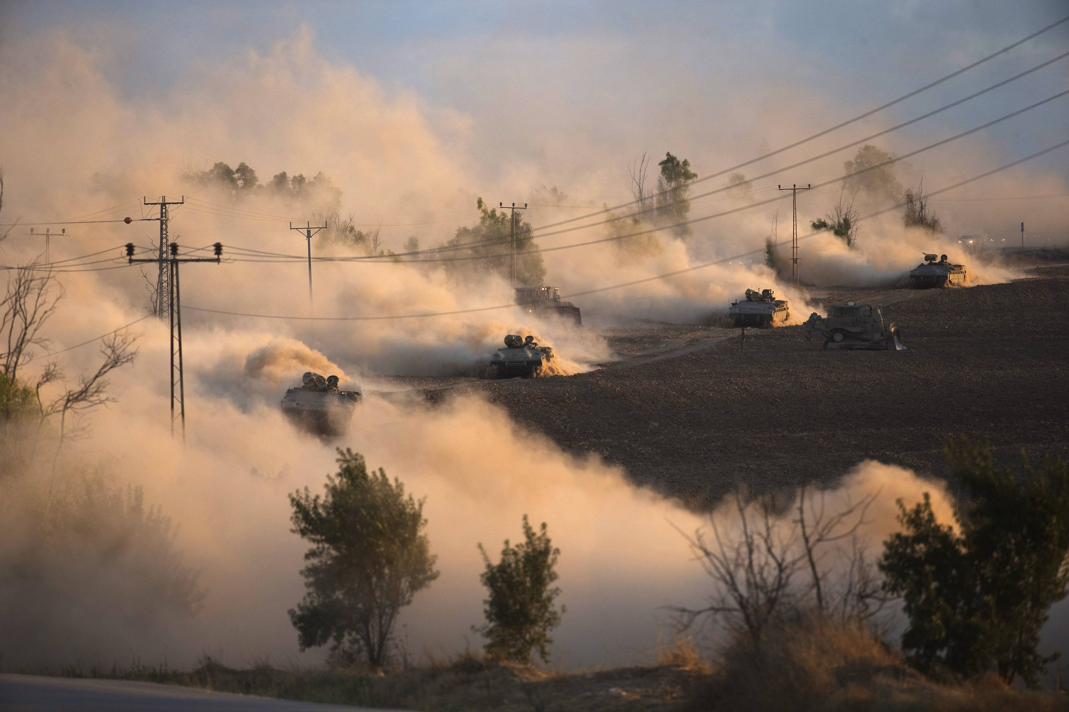 Israeli tanks maneuver outside the Gaza Strip on July 18, 2014.