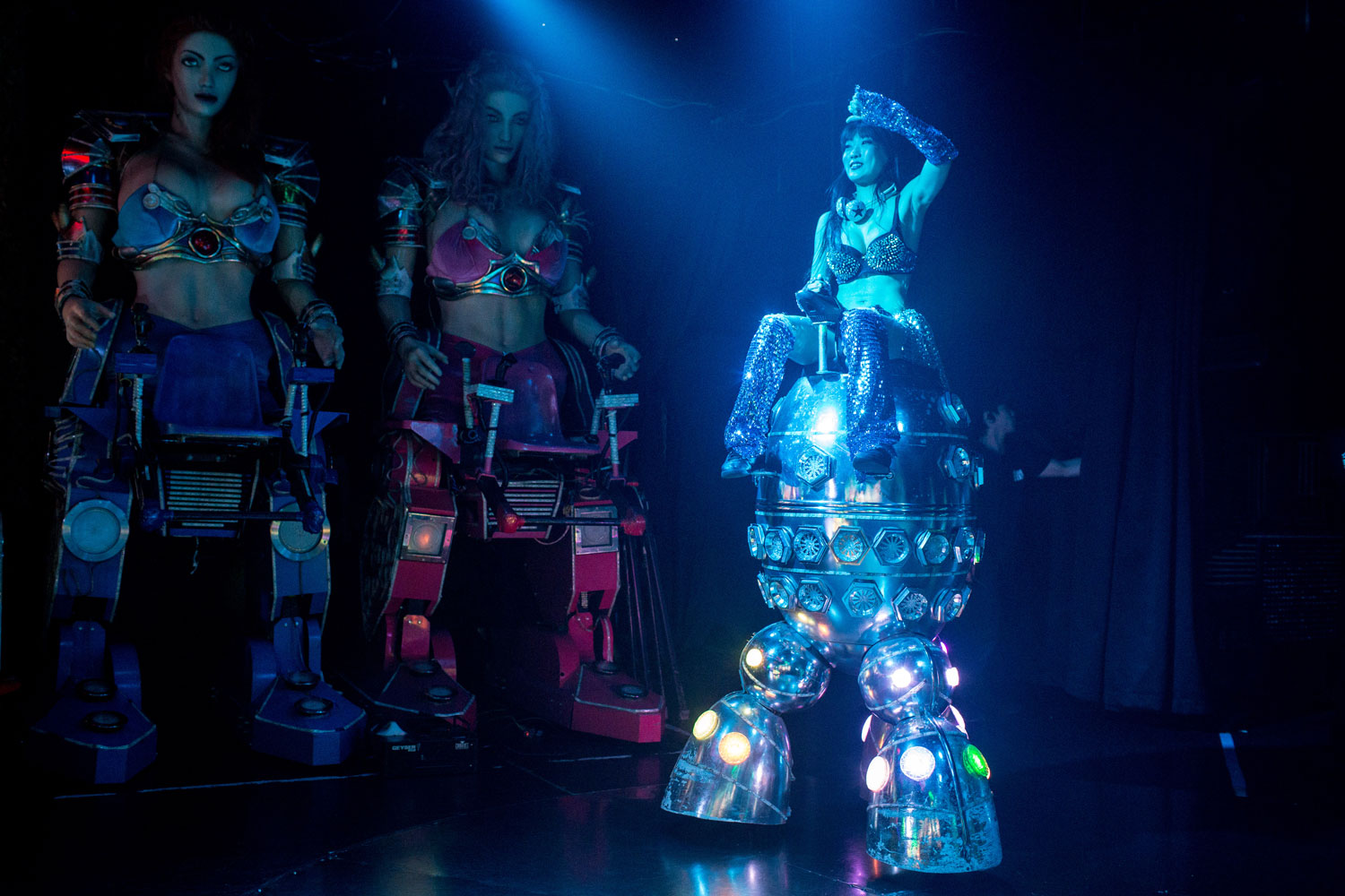 A dancer rides a robotic vehicle during a show at The Robot Restaurant on June 29, 2014 in Tokyo.