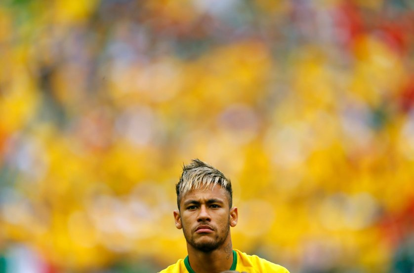 Brazil's Neymar stands during the 2014 World Cup Group A soccer match between Brazil and Mexico at the Castelao arena