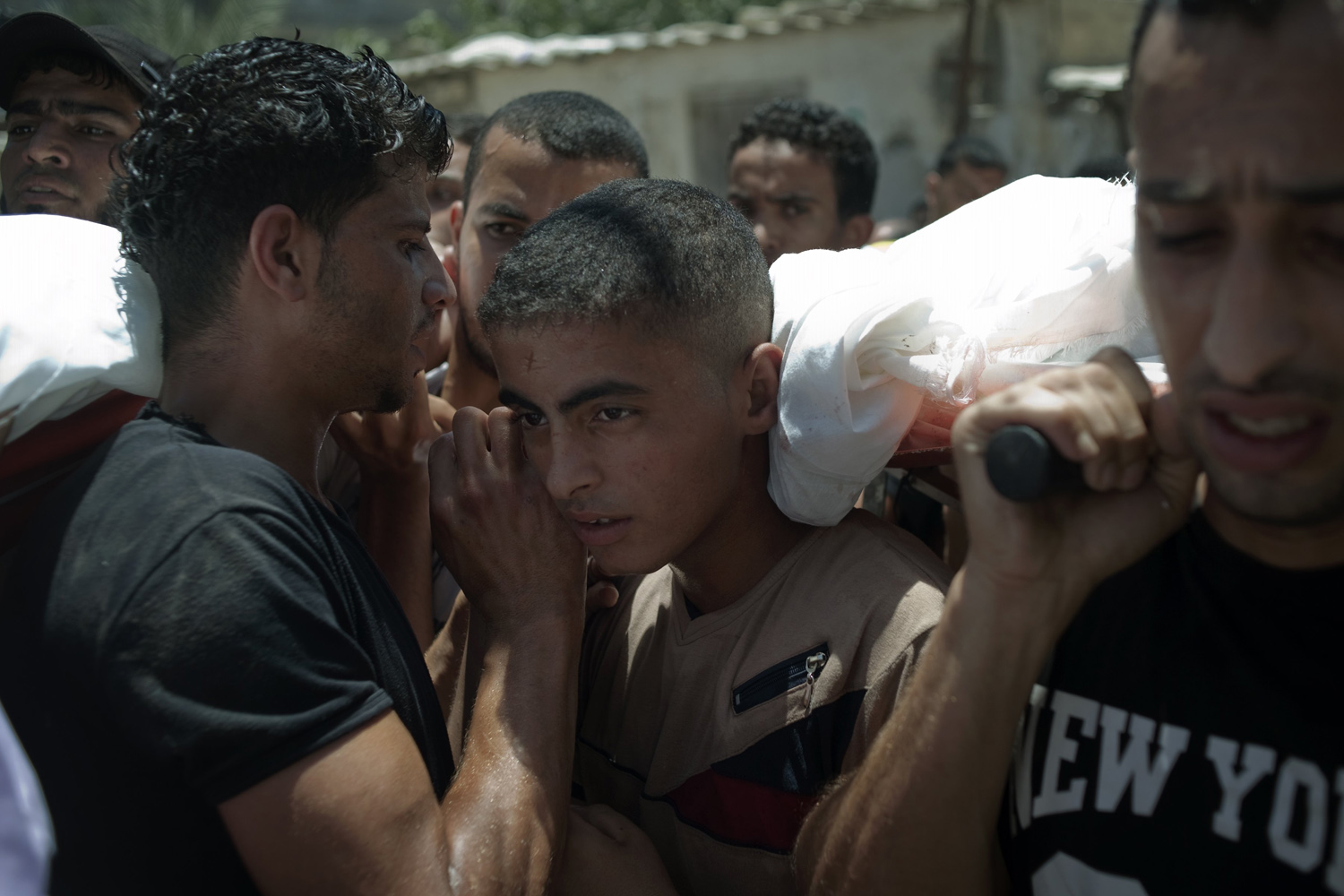 Jul. 10, 2014. Palestinian mourners carry the body of a Al Haj family member during the family's funeral in Khan Yunis, Palestine. A total of 8 family members of the Al Haj family died in an Israeli Airstrike during Operation Protective Edge of Israel.