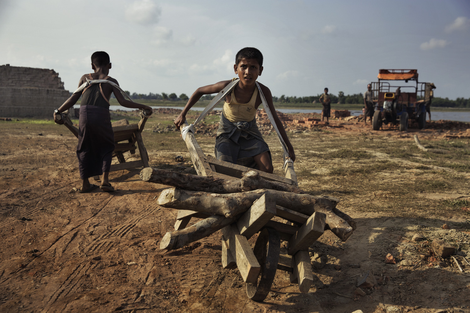 Children working at a brick kiln where they earn $1 a day.