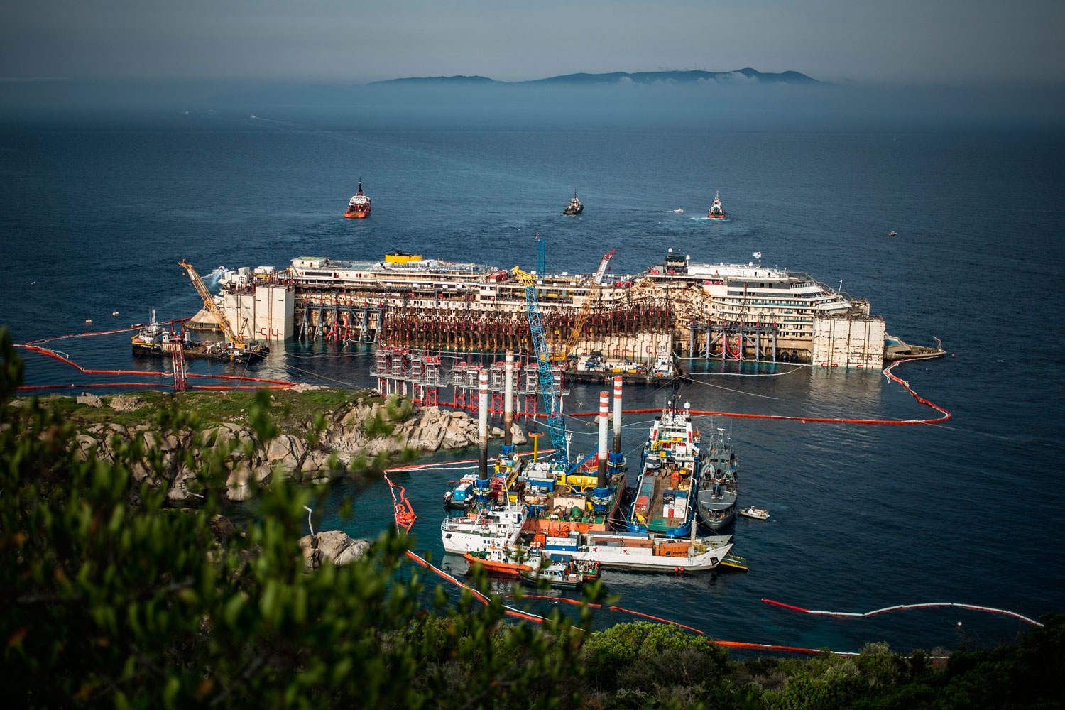 The Costa Concordia wreck re-float operation on July 21, 2014 in Giglio Porto, Italy. The 114,500 ton ship ran aground in January of 2012. The ships captain could face 20 years in prison.