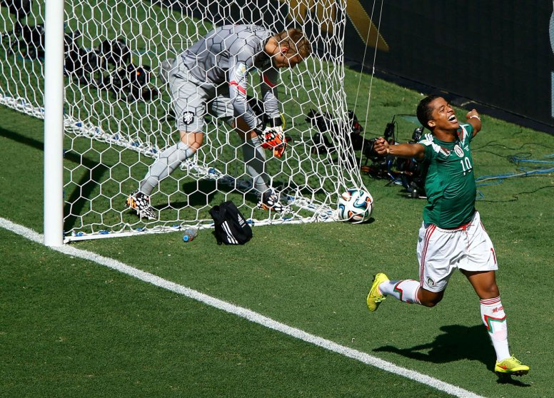 Jasper Cillessen of the Netherlands picks the ball out of the net as Mexico's Giovani Dos Santos celebrates his goal during their game at the Castelao arena in Fortaleza , Brazil on June 29, 2014.