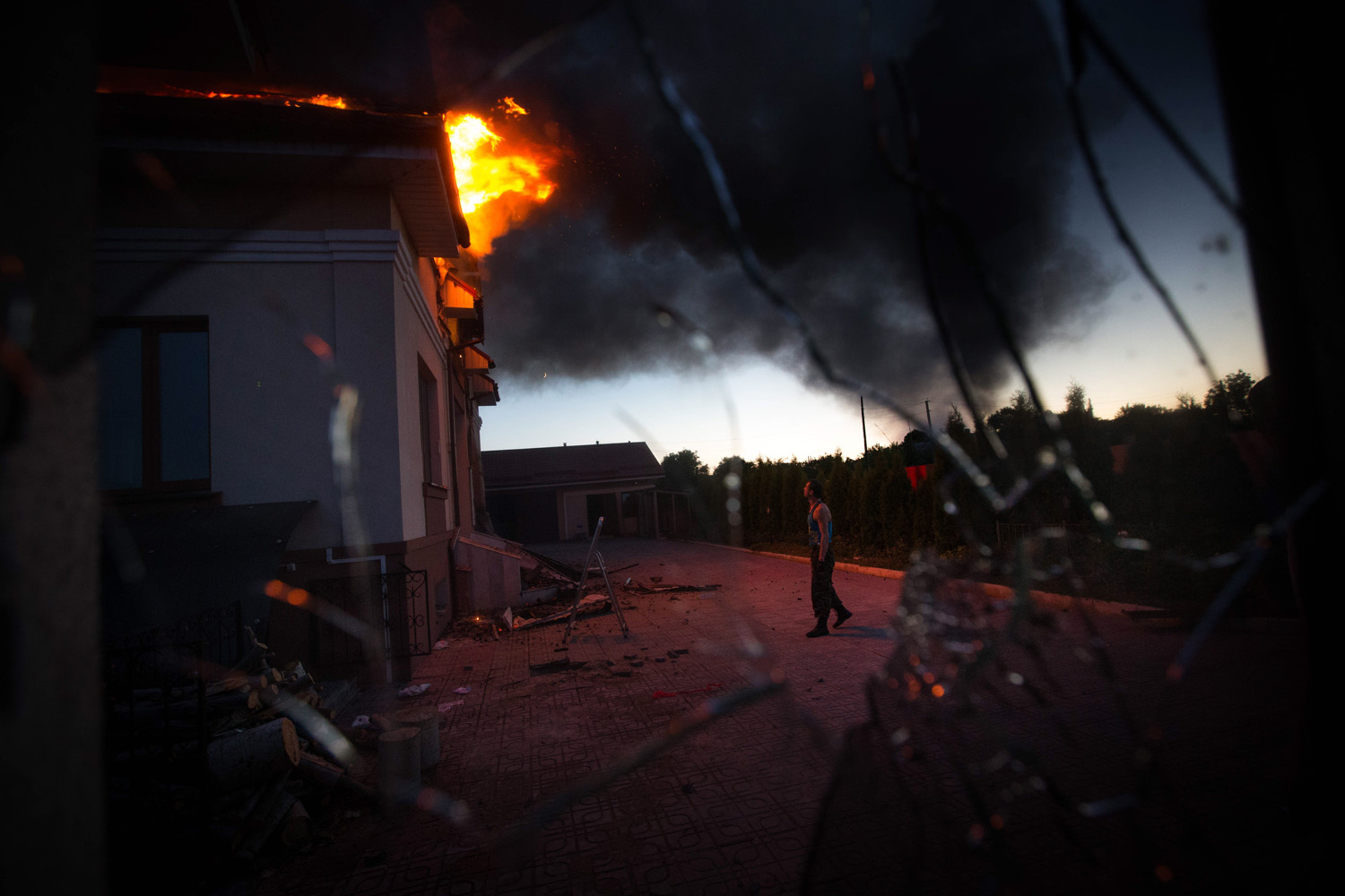 Jul. 2, 2014. A house in the village of Nikolayevka catches fire as a result of a mortar attack on Lugansk suburbs.