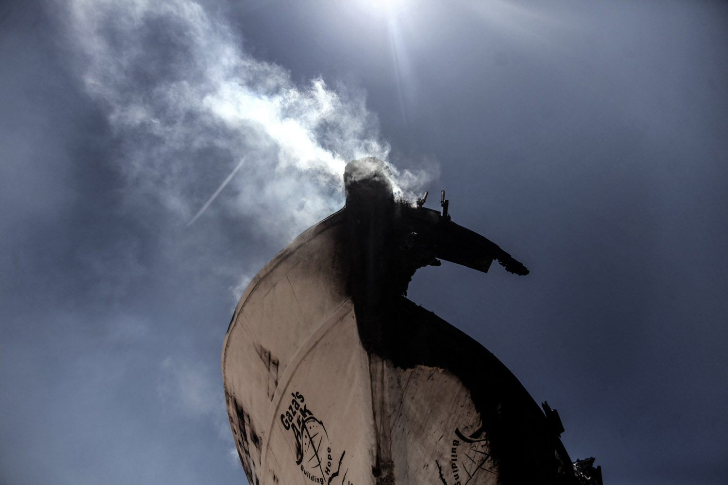Jul 11, 2014. Smoke rises from the peace activists boat 'Gaza's Ark' following an Israeli air strike during the fighting between Israeli navy and Hamas militants next to the beach in the west of Gaza City.