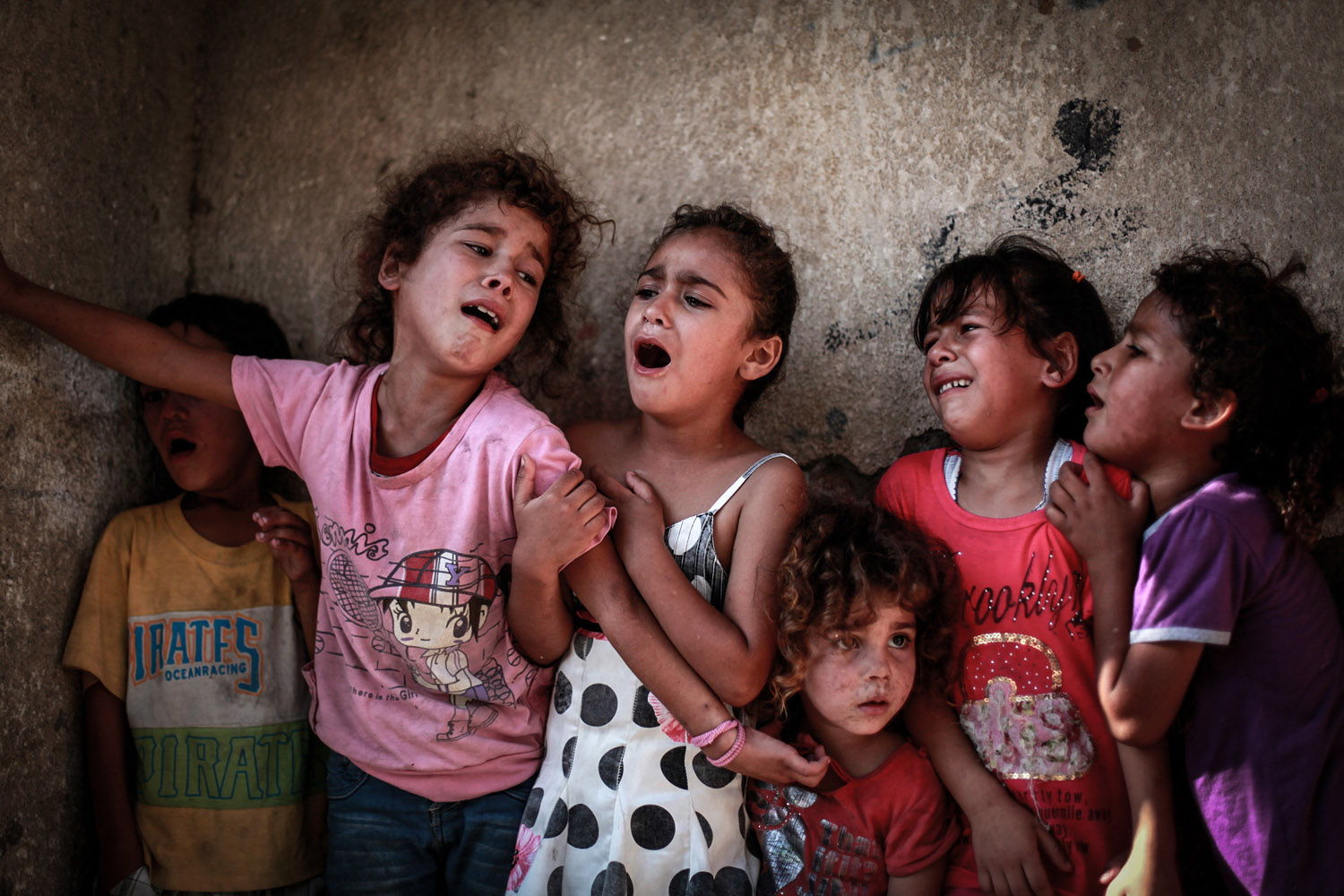 Jul. 16, 2014. Palestinian relatives of the four boys killed in Israeli bombardment, all from the Bakr family, cry at the morgue of the hospital in Gaza City.