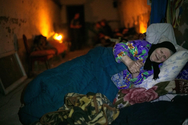 Jul.29, 2014. A local resident, Lyubov Konstantinovna lies on a bed in bomb shelter in Gorlovak, Donetsk, Ukraine.
