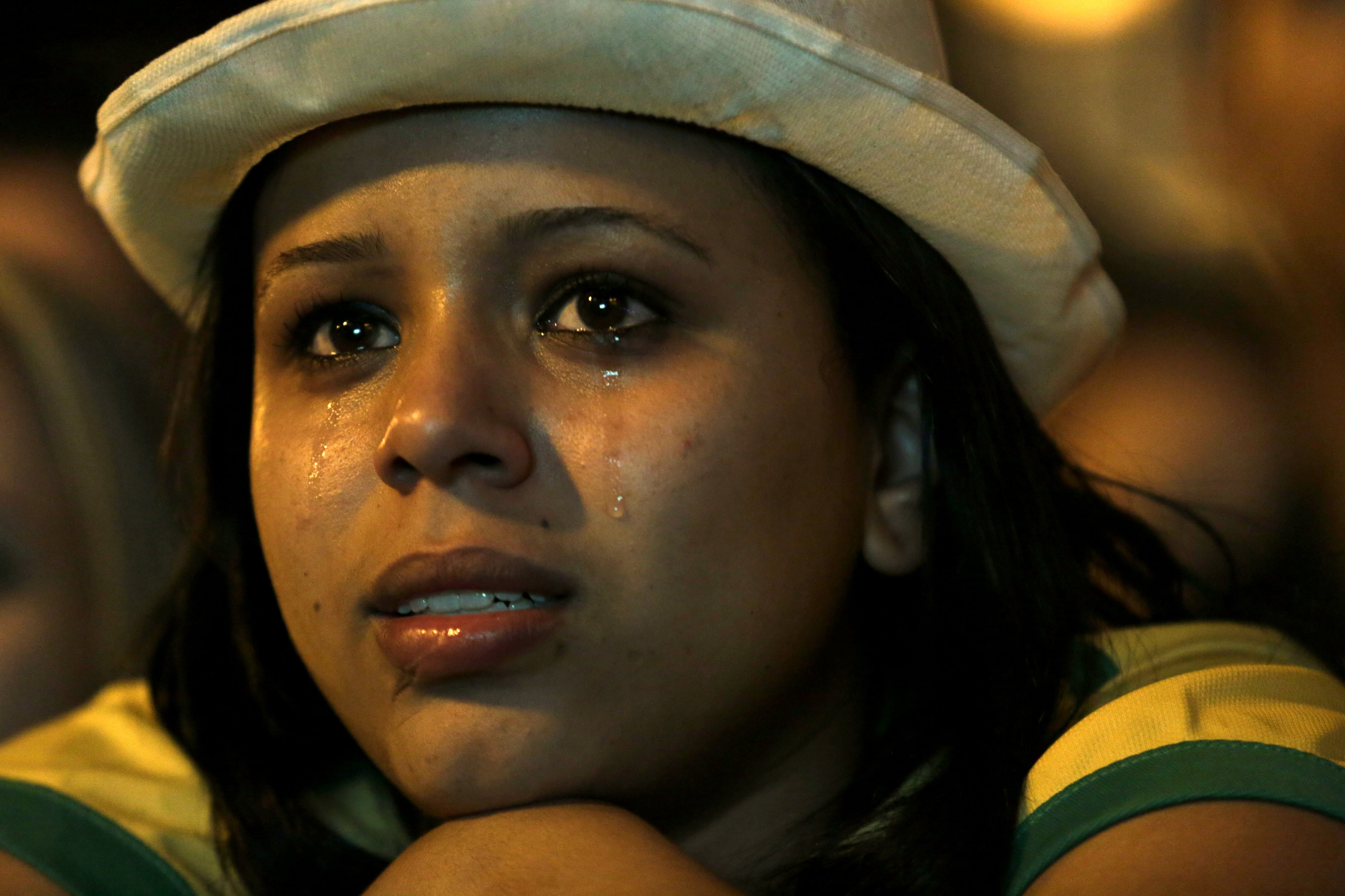 A Brazil soccer fan cries as she watches her team lose to Germany in Belo Horizonte, Brazil on July 8, 2014.