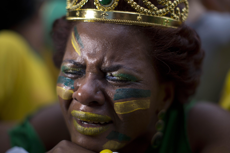 A fan of Brazil weeps after Germany scores in Sao Paulo, Brazil on July 8, 2014.