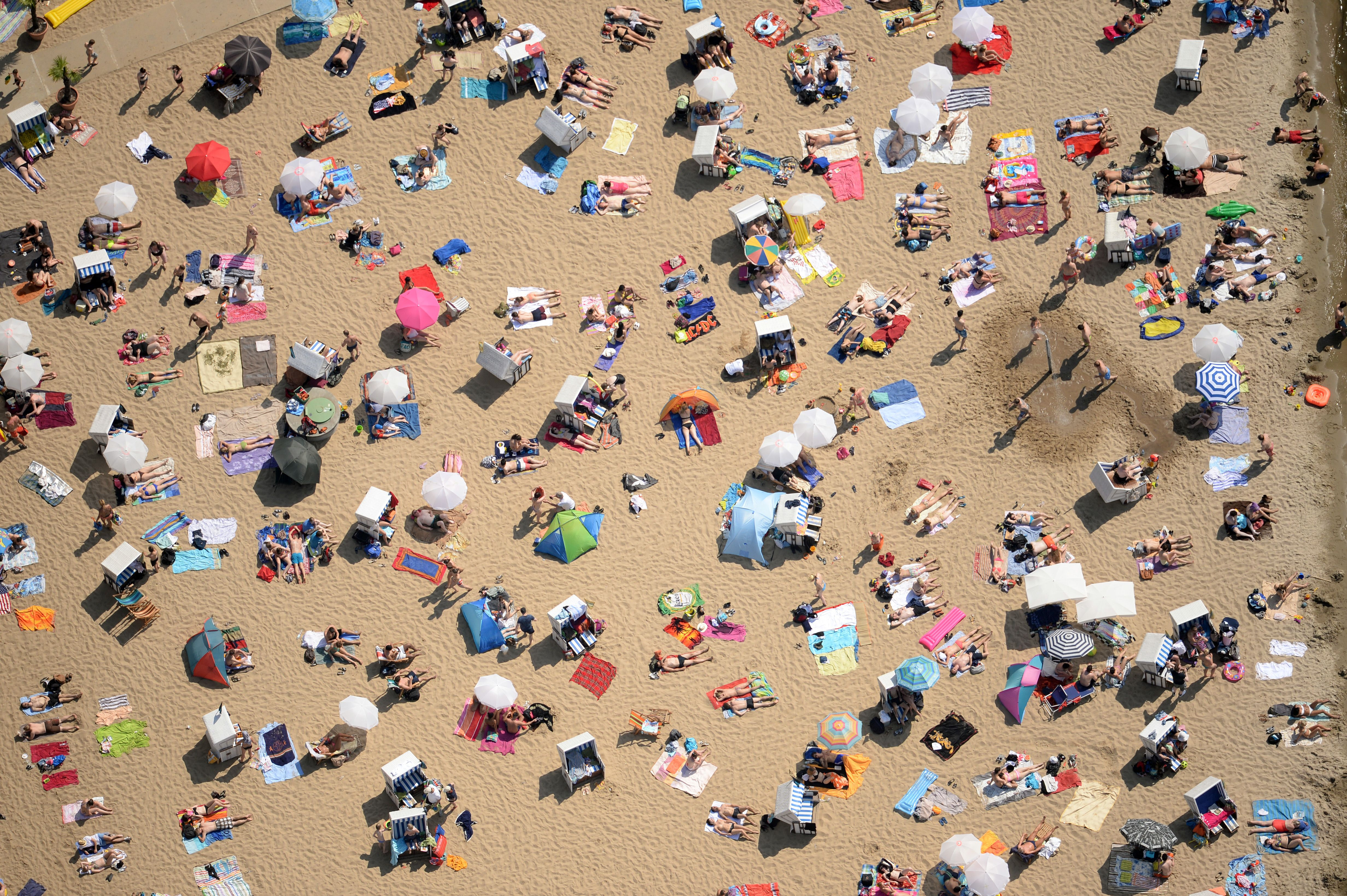 An aerial view shows people crowding the beach of the lake Wannsee in Berlin, eastern Germany, on June 8, 2014.