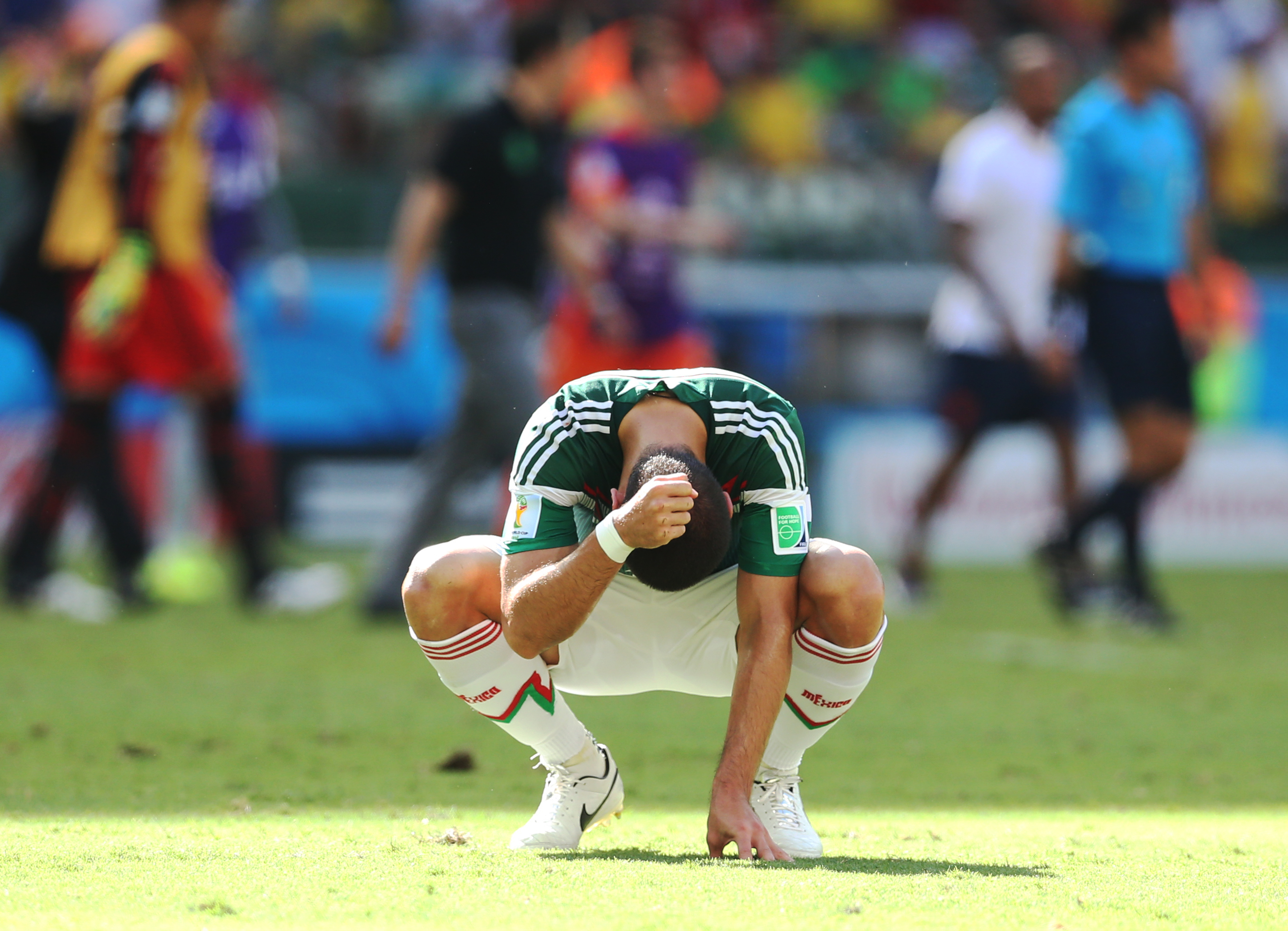 A dejected Javier 'Chicharito' Hernandez of Mexico at the final whistle during the Round of 16 match of the 2014 World Cup between Netherlands and Mexico at the Estadio Castelao on June 29, 2014 in Fortaleza, Brazil.