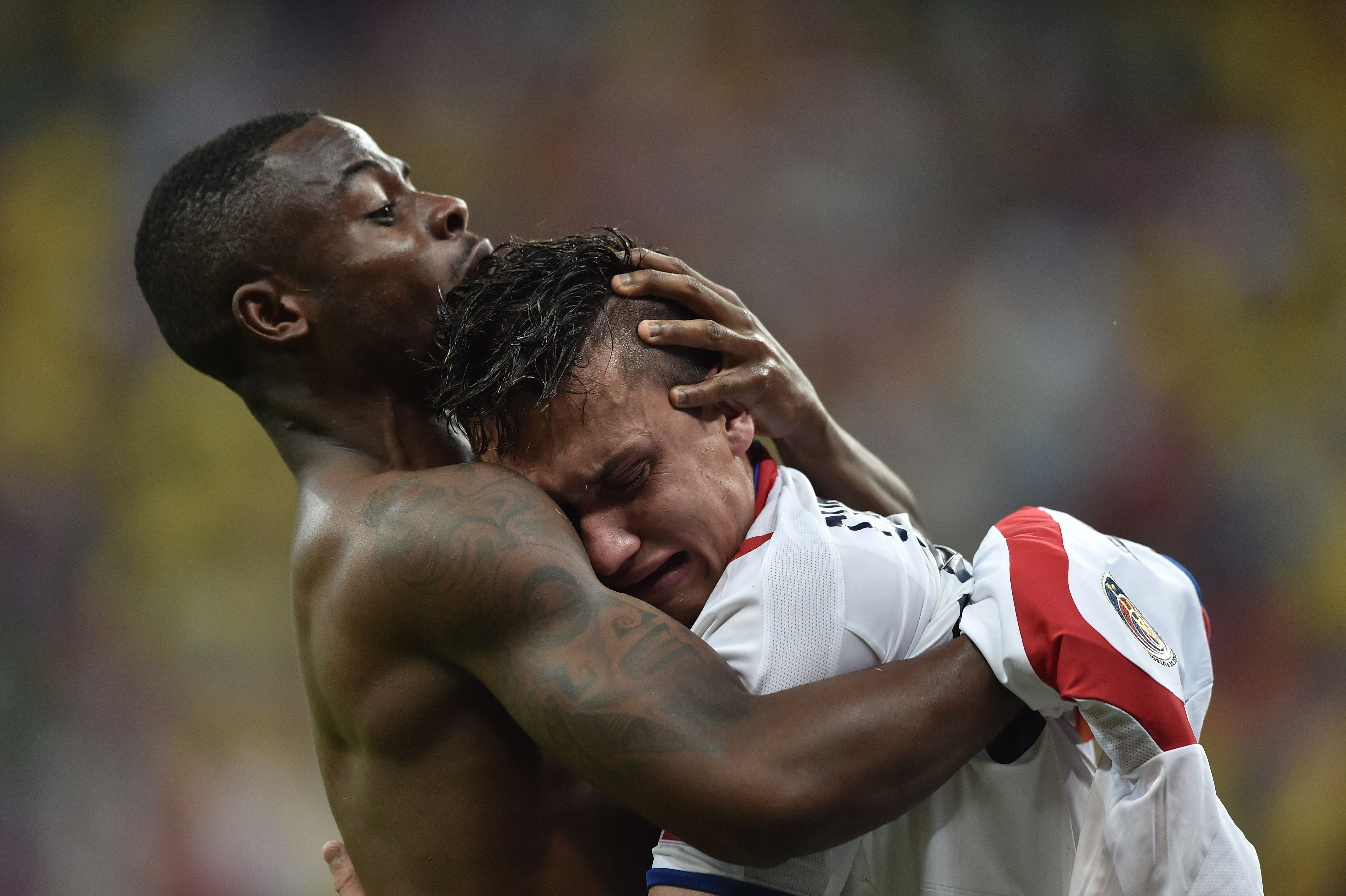 Costa Rica's defender Waylon Francis (L) and Costa Rica's midfielder Jose Miguel Cubero celebrate after winning a match with Greece during the 2014 FIFA World Cup on June 29, 2014.