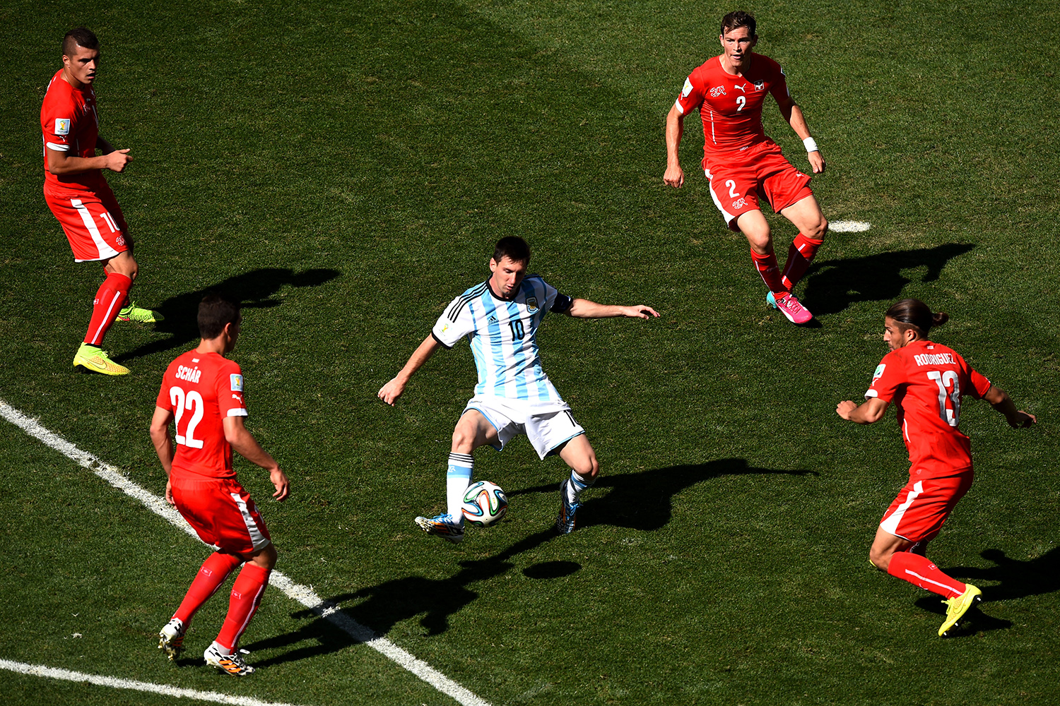 July 1, 2014. Lionel Messi of Argentina controls the ball against Josip Drmic (L), Fabian Schar (2nd L), Stephan Lichtsteiner (2nd R) and Ricardo Rodriguez of Switzerland during the 2014 FIFA World Cup Brazil Round of 16 match between Argentina and Switzerland at Arena de Sao Paulo in Sao Paulo, Brazil.