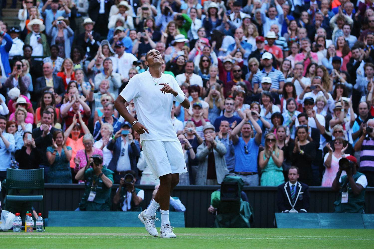 Nick Kyrgios of Australia celebrates match point and winning his Gentlemen's Singles fourth round match against Rafael Nadal of Spain on day eight of the Wimbledon Lawn Tennis Championships at the All England Lawn Tennis and Croquet Club in London on July 1, 2014.