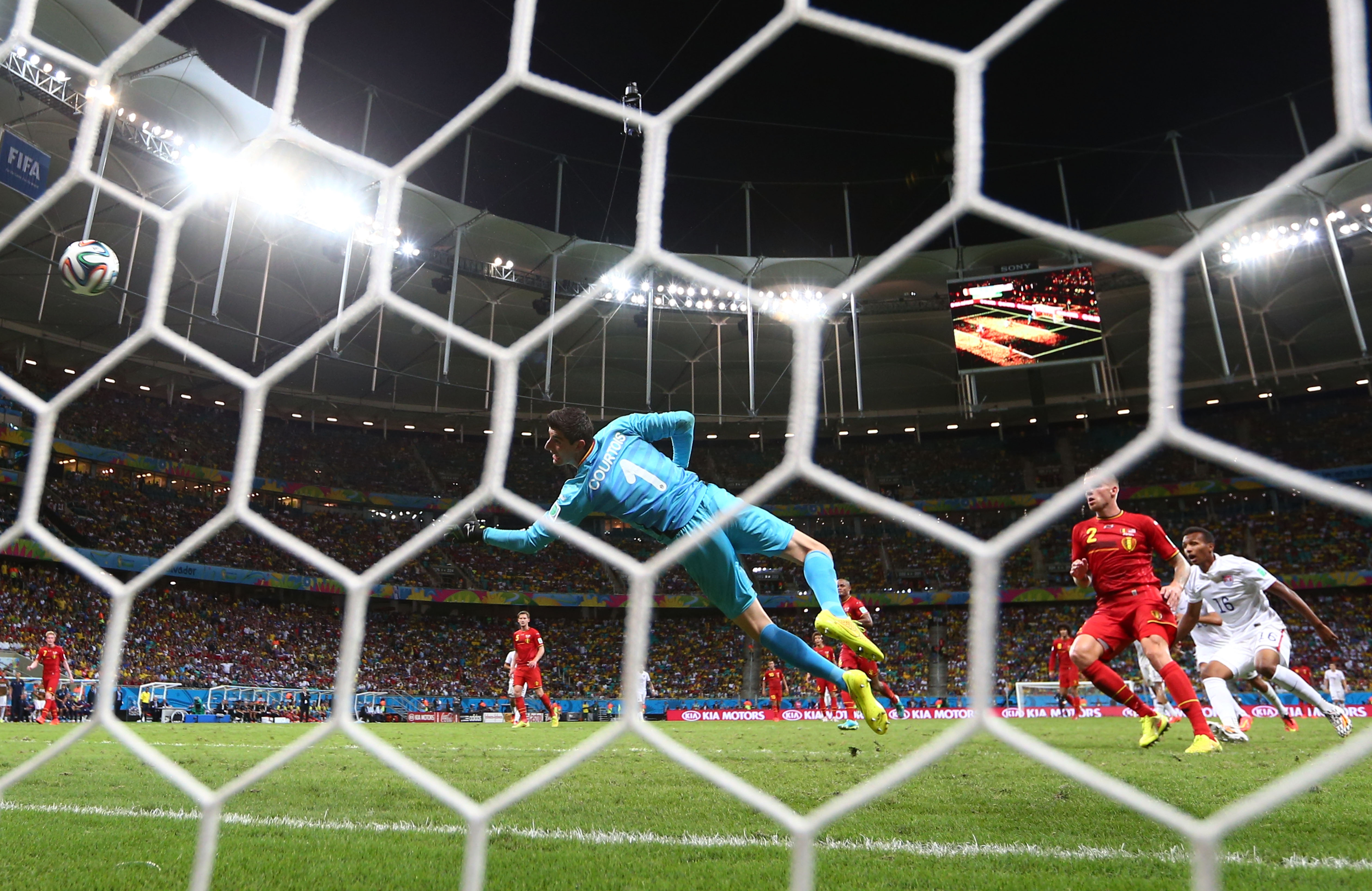 SALVADOR, BRAZIL - JULY 01:  Julian Green of the United States scores his team's first goal past Thibaut Courtois of Belgium in extra time during the 2014 FIFA World Cup Brazil Round of 16 match between Belgium and the United States at Arena Fonte Nova on July 1, 2014 in Salvador, Brazil.  (Photo by Michael Steele/Getty Images)