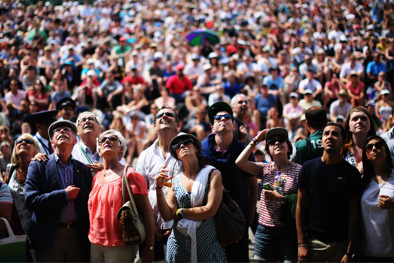 Jul. 2, 2014. Fans on Murray mound look up at the big screen as they watch the Andy Murray against Grigor Dimitrov match on day nine the Wimbledon Lawn Tennis Championships at the All England Lawn Tennis and Croquet Club  at Wimbledon in London, England.