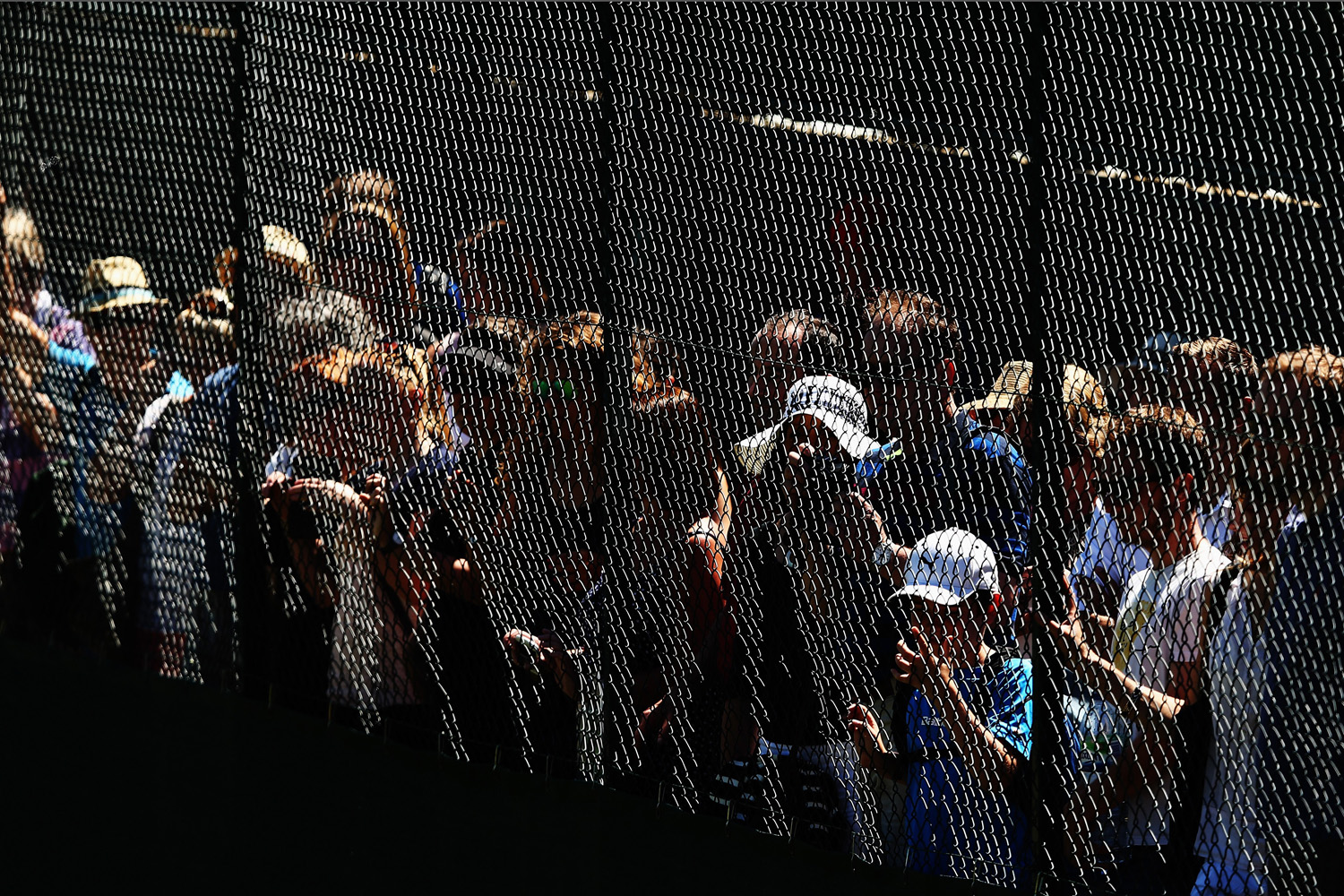Jul. 3, 2014. Spectators watch the action on the practice courts on day ten of the Wimbledon Lawn Tennis Championships at the All England Lawn Tennis and Croquet Club  in London, England.