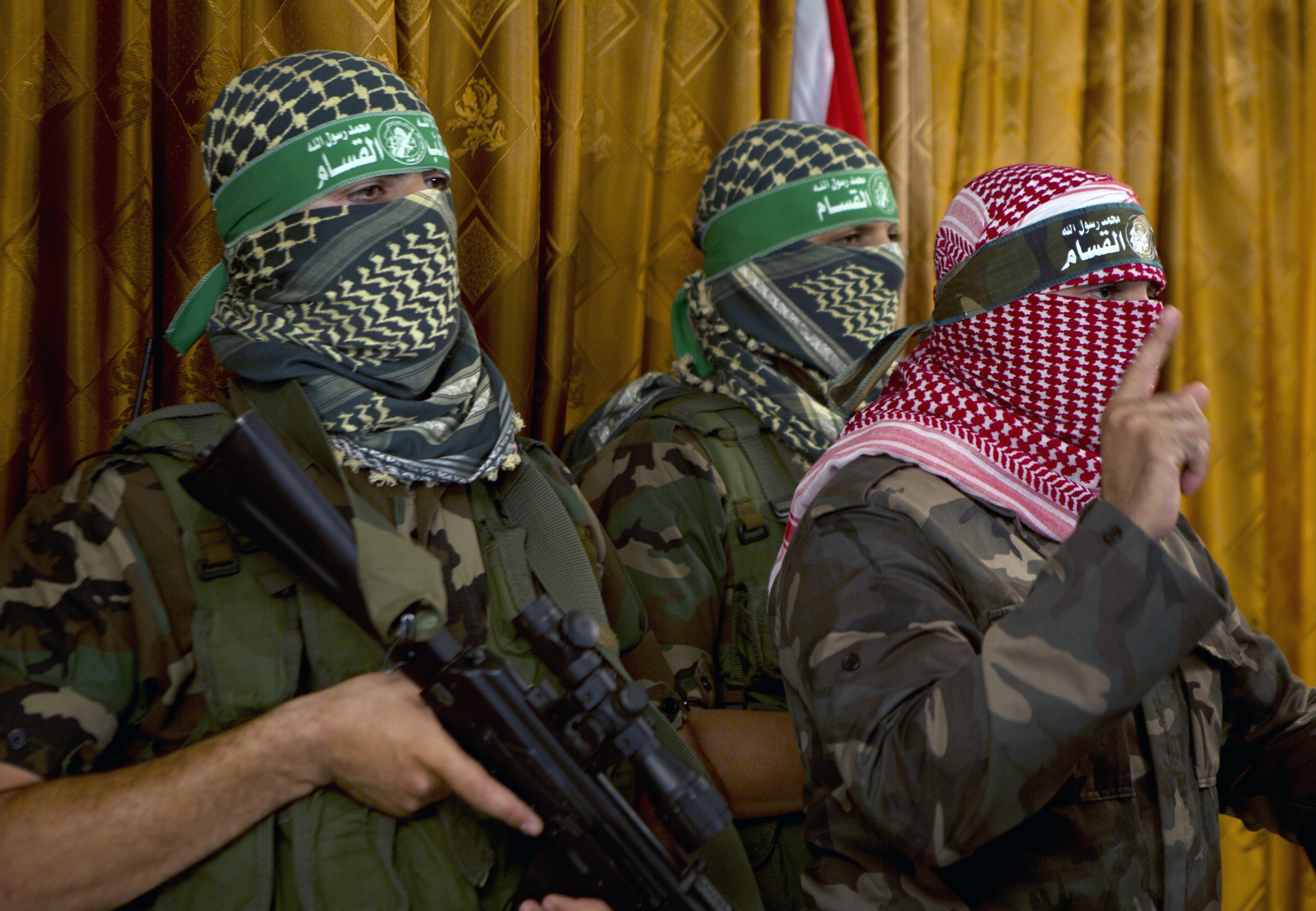 Abu Obeida, right, the official spokesperson of the Palestinian militant group Ezzedine al-Qassam brigade, the armed wing of Hamas, give a press conference on July 3, 2014 in Gaza City.