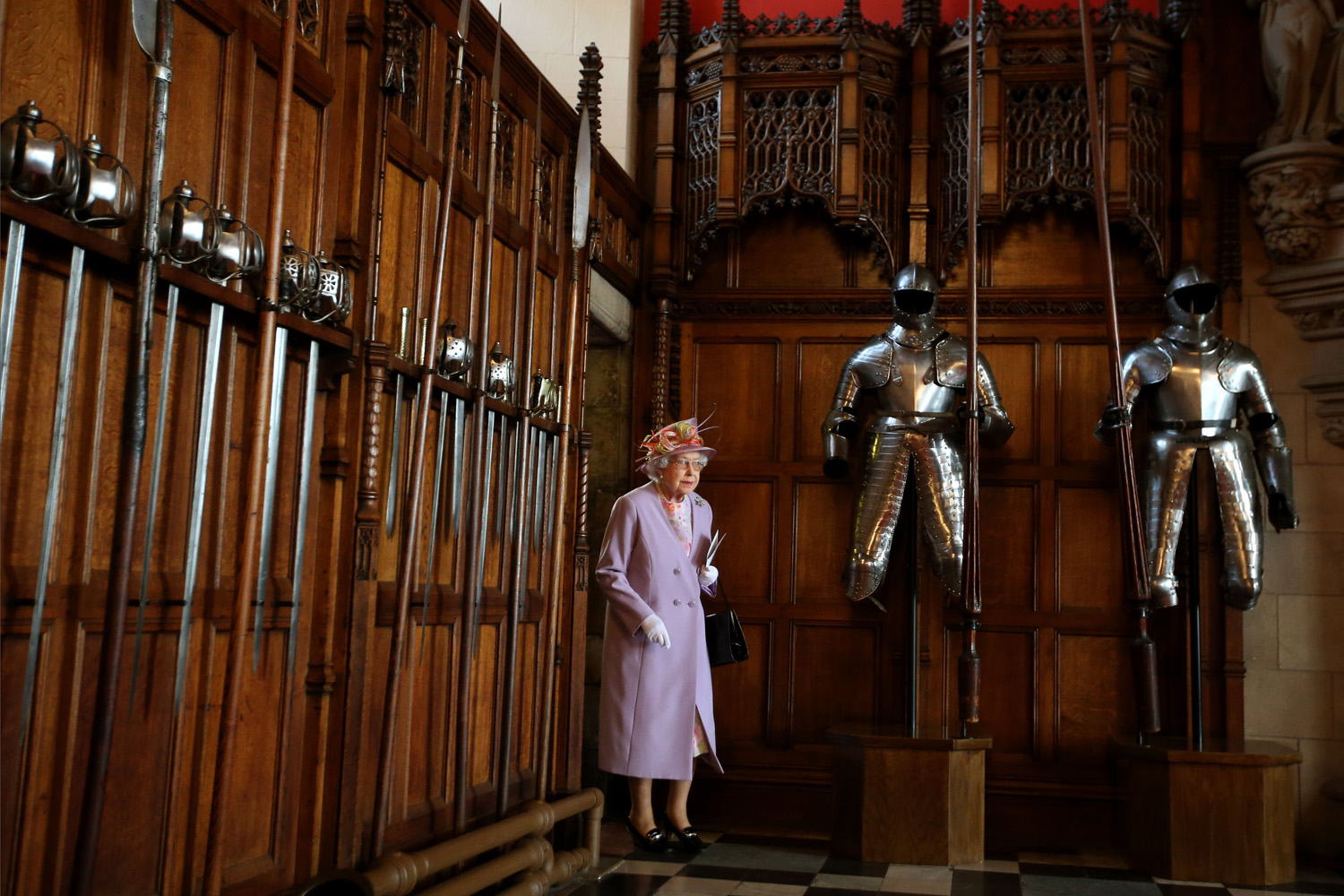 Jul. 3, 2014. Queen Elizabeth II enters the Great Hall at Edinburgh Castle to meet those associated with the Memorial after attending a commemorative service for the Scottish National War Memorial at Edinburgh Castle in Edinburgh, Scotland, United Kingdom.