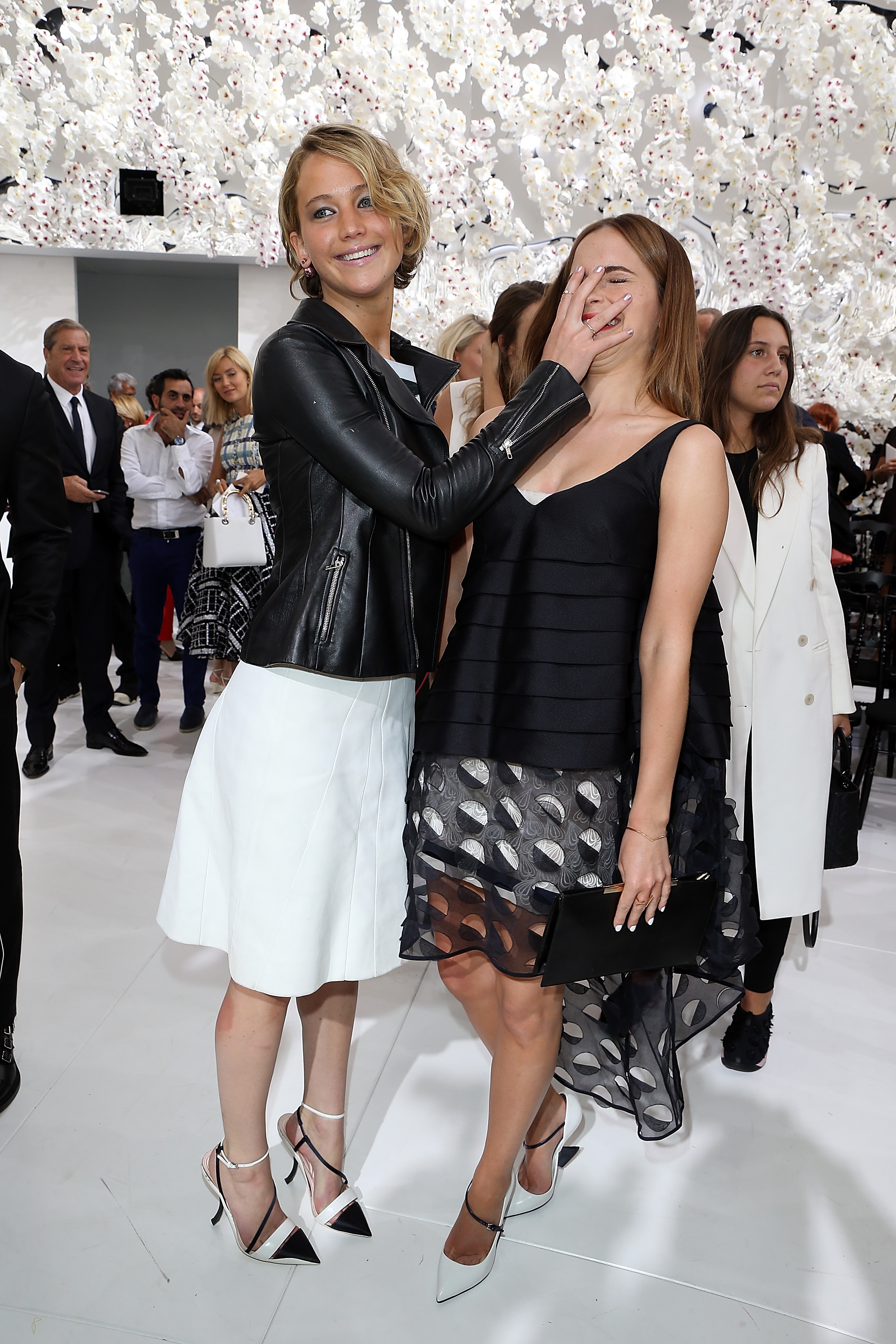 Jennifer Lawrence and Emma Watson attend the Christian Dior show as part of Paris Fashion Week