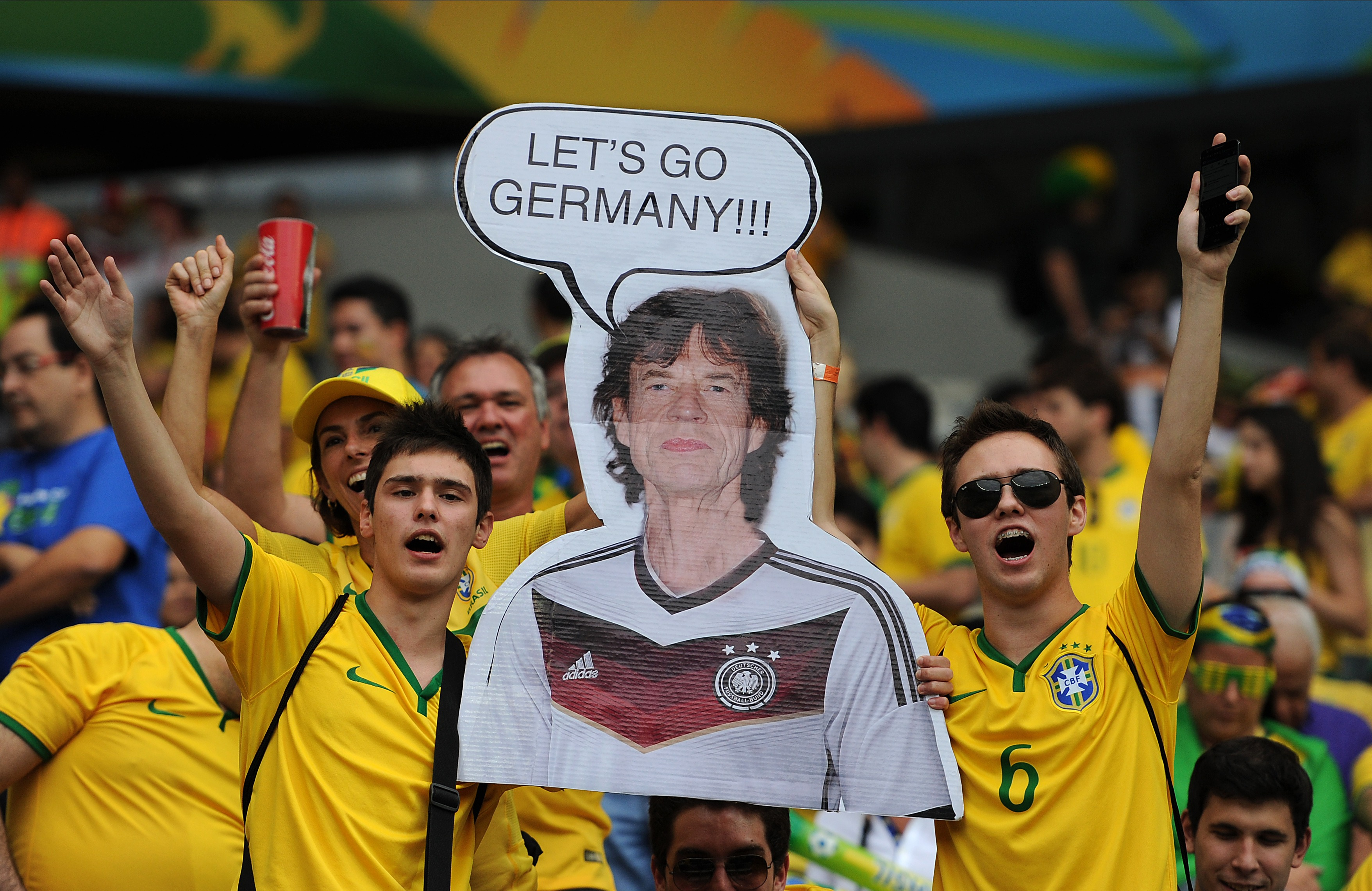 Brazil fans hold up a poster of Mick Jagger during the World Cup semifinal match between Brazil and Germany in Belo Horizonte, Brazil, on July 8, 2014