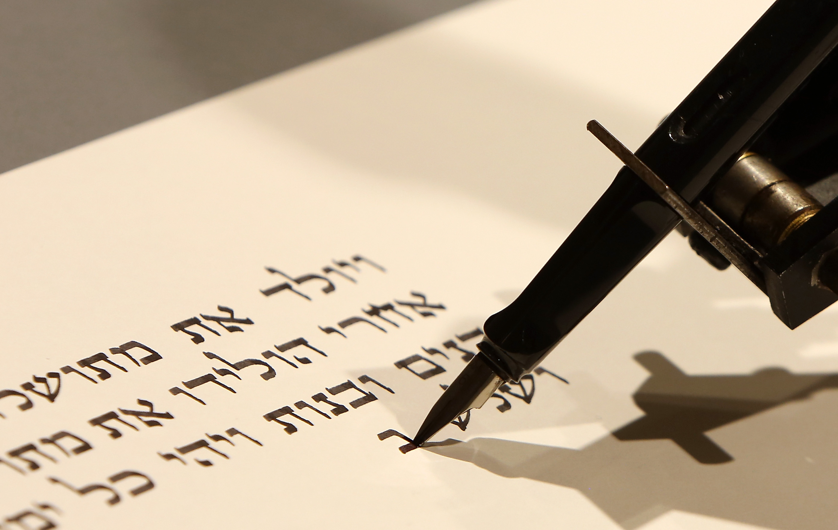 An industrial robot, an installation work called 'bios [torah]' by the artist group robotlab, begins writing a Torah on July 10, 2014 in the Jewish Museum in Berlin, Germany.