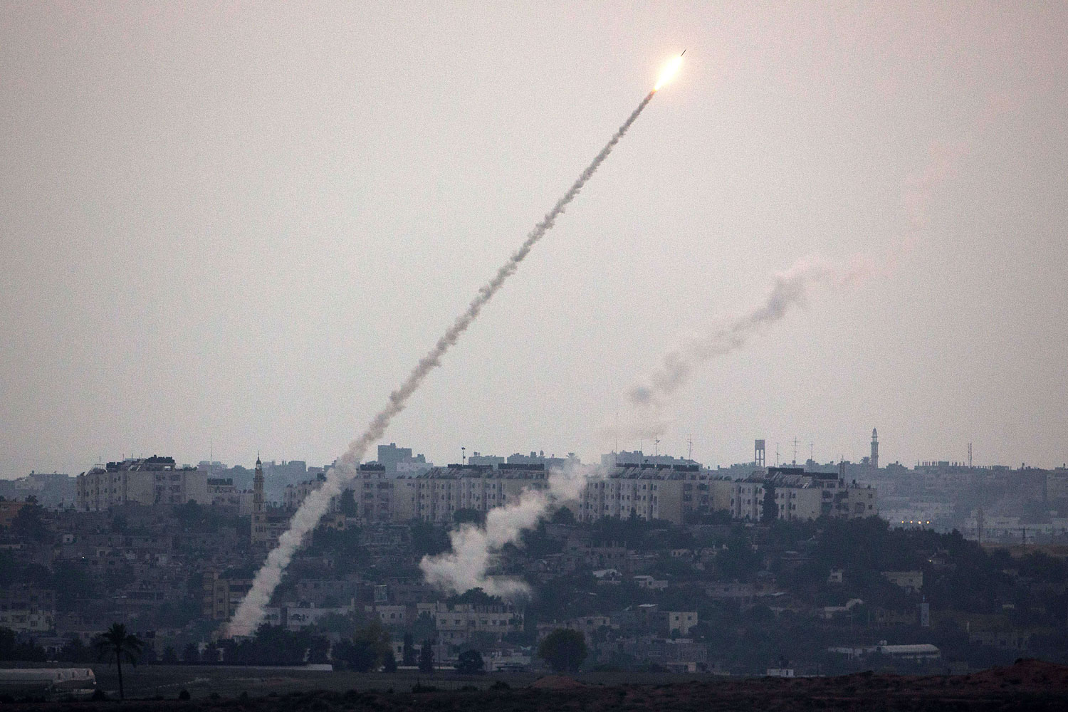 A picture taken from the southern Israeli Gaza border shows a militant rocket being launched from the Gaza strip into Israel, on July 11, 2014.