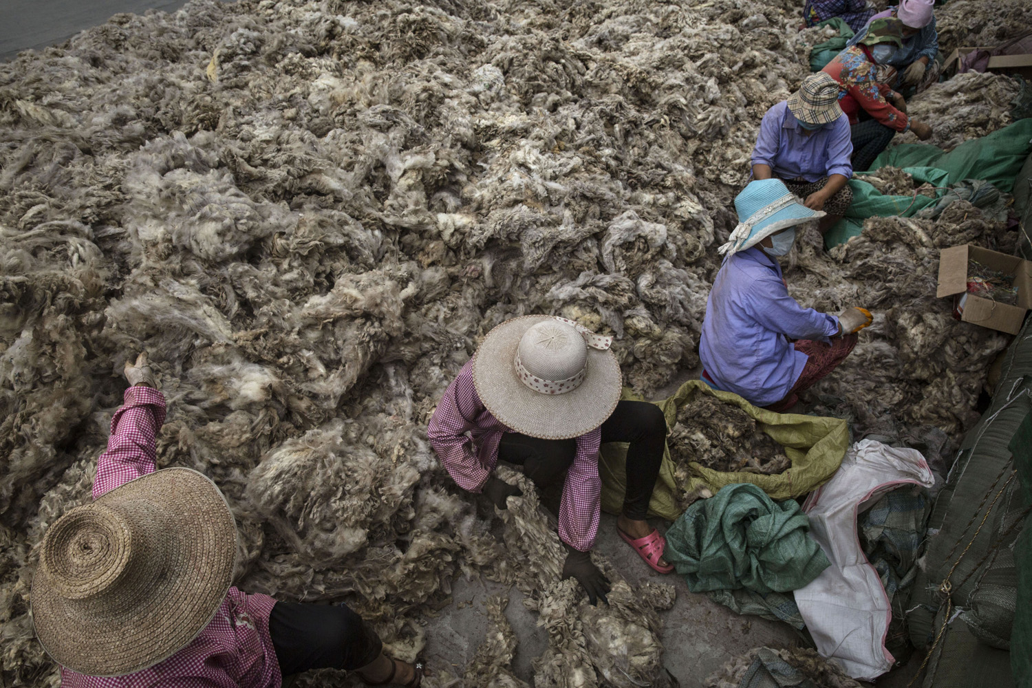 Jul. 12, 2014. Chinese workers prepare sheep's wool before it is processed and bleached at a factory near Zhangzhou, China.