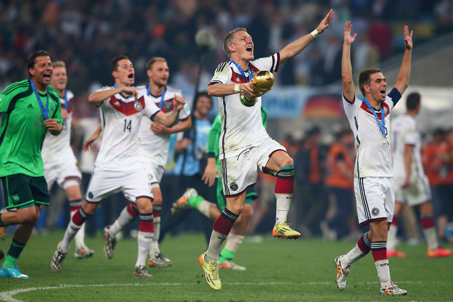 Jul. 13, 2014.  Bastian Schweinsteiger of Germany celebrates with the World Cup trophy after defeating Argentina 1-0 in extra time during the 2014 FIFA World Cup Brazil Final match between Germany and Argentina at Maracana in Rio de Janeiro, Brazil.