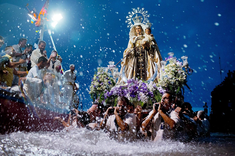 Jul. 15, 2014. Carriers of the Great God Power brotherhood unload the Virgen del Carmen statue at Puerto de la Cruz dock on the Canary island of Tenerife, Spain.