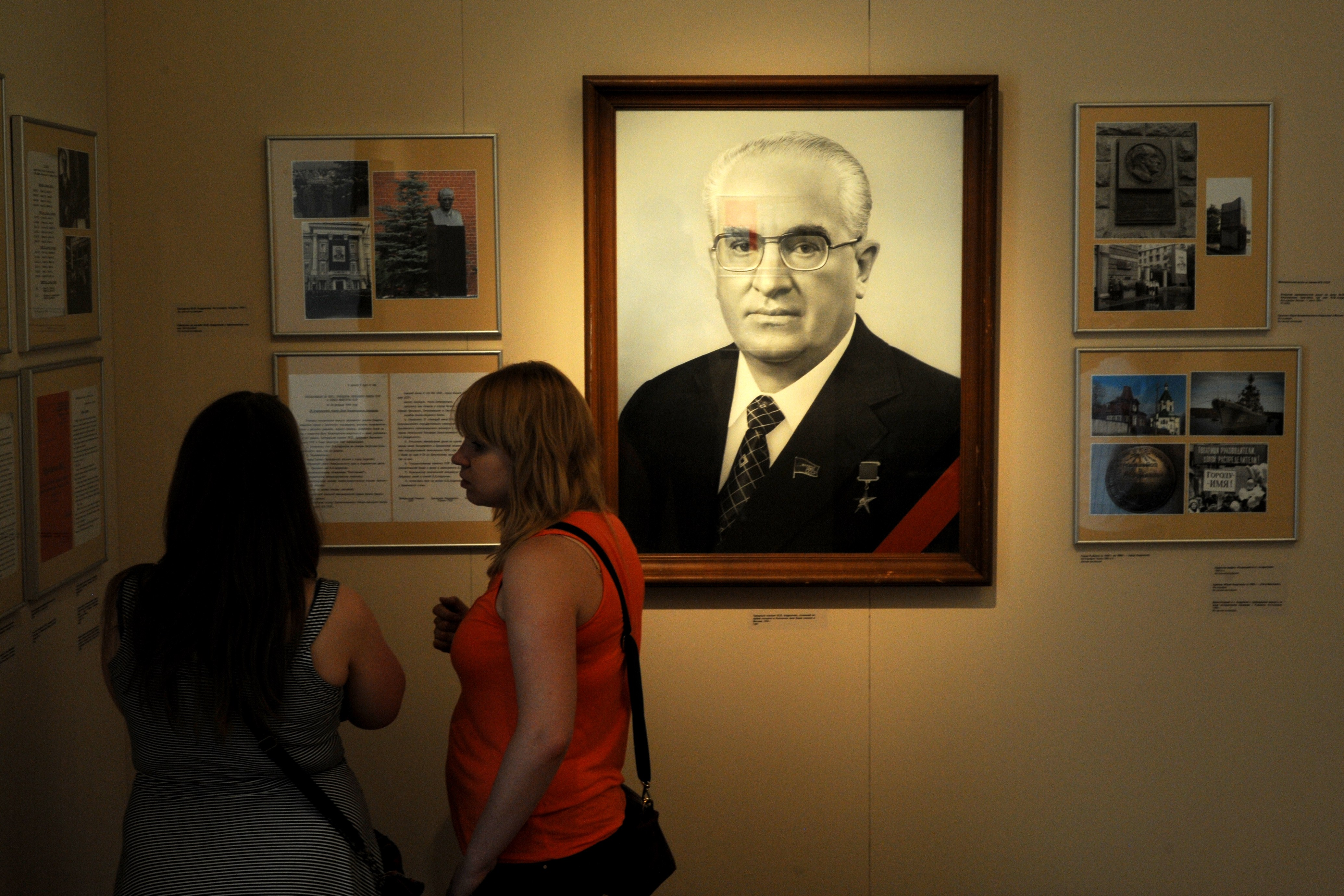 Visitors view an exhibition dedicated to the former Communist leader and KGB head, Yuri Andropov, in Moscow, on July 6, 2014. Nostalgic about the might of vanished Soviet empire, Russia marked the 100th anniversary of Andropov's birth with exhibitions and television films glorifying the Soviet leader who was in charge when his nation's military shot down KAL 007 in 1983.