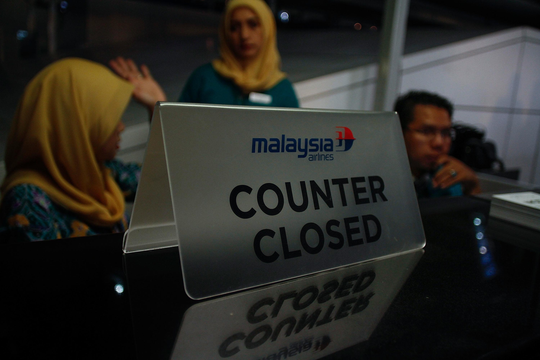 Malaysia Airlines crew closed the counter at Kuala Lumpur International Airport Terminal 1 on July 18, 2014 in Putrajaya, Malaysia.