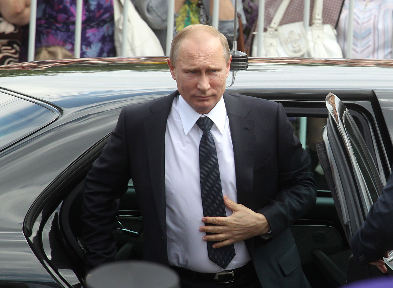 Russian President Vladimir Putin arrives for the Orthodox festival to honour the birthday of Venerable Sergius of Radonezh in the Trinity Lavra of St.Sergius on July 18, 2014, in Sergiyev Posad.