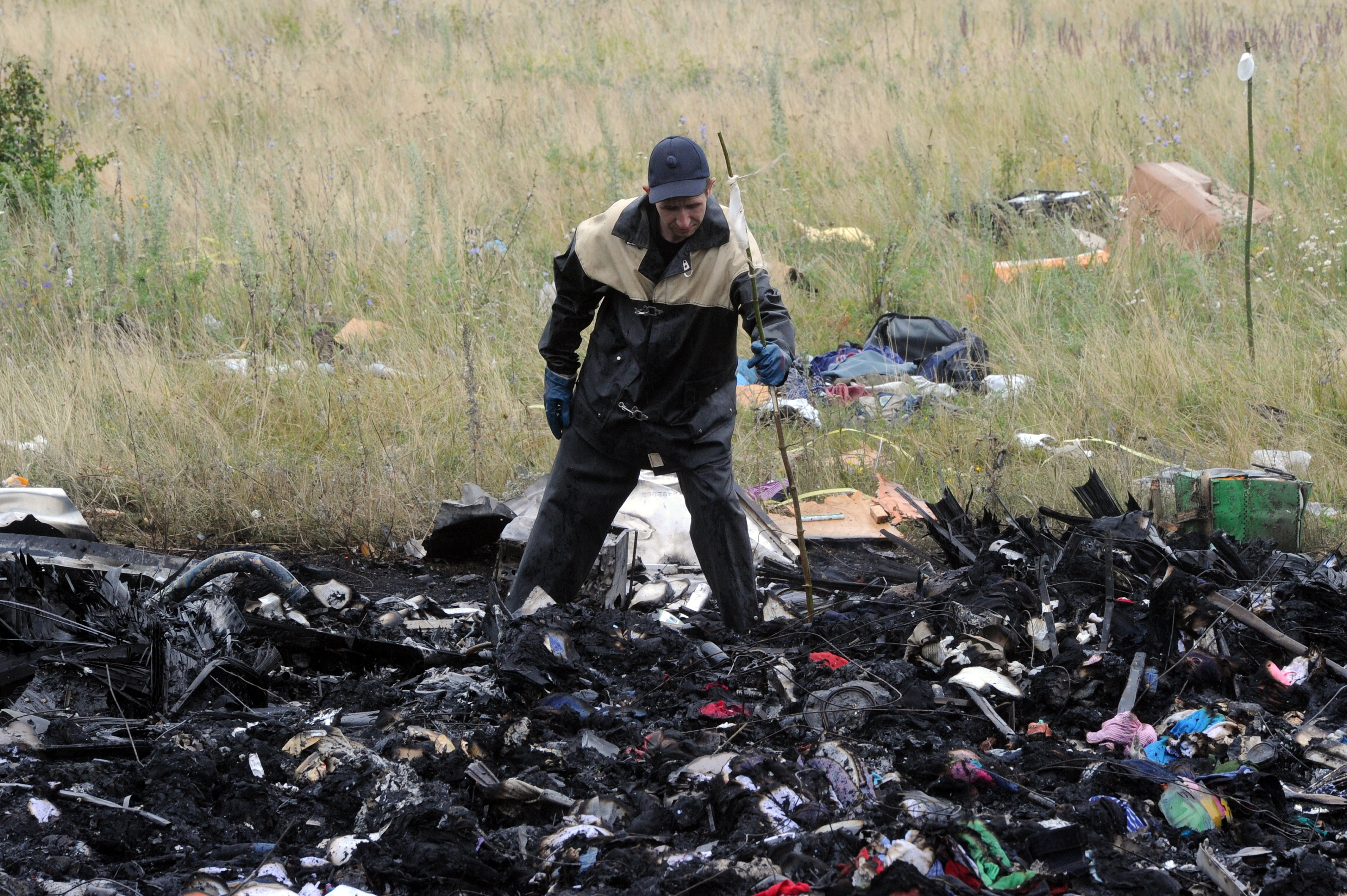 A rescue worker uses sticks to mark the location where bodies of victims have been found at the site of the crash of a Malaysian airliner carrying 298 people from Amsterdam to Kuala Lumpur in Grabove, in rebel-held east Ukraine, on July 18, 2014.