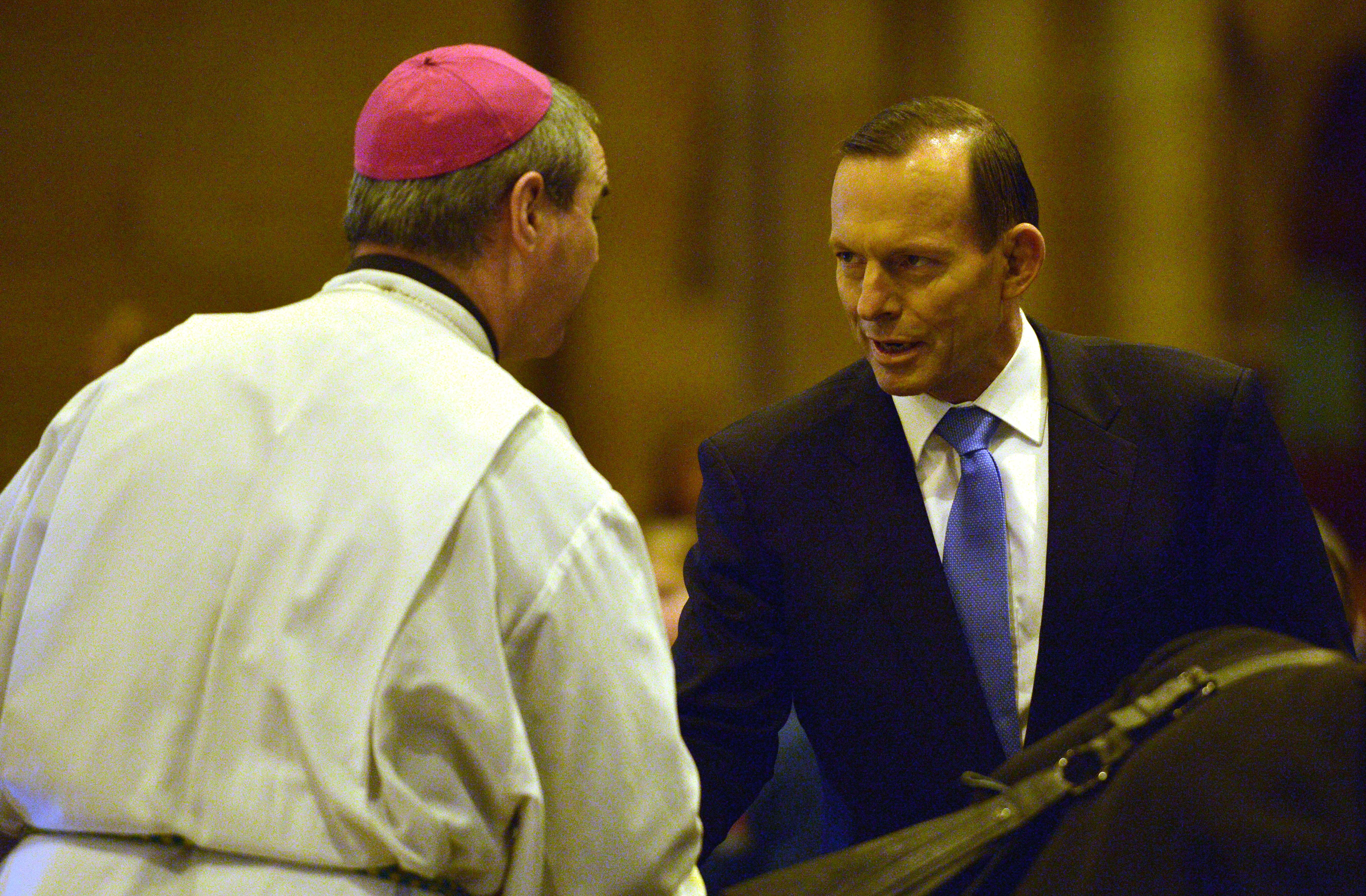 Australian Prime Minister Tony Abbott, right, attends a service for victims of Malaysia Airlines Flight 17 at St. Mary's Cathedral in Sydney on July 20, 2014.