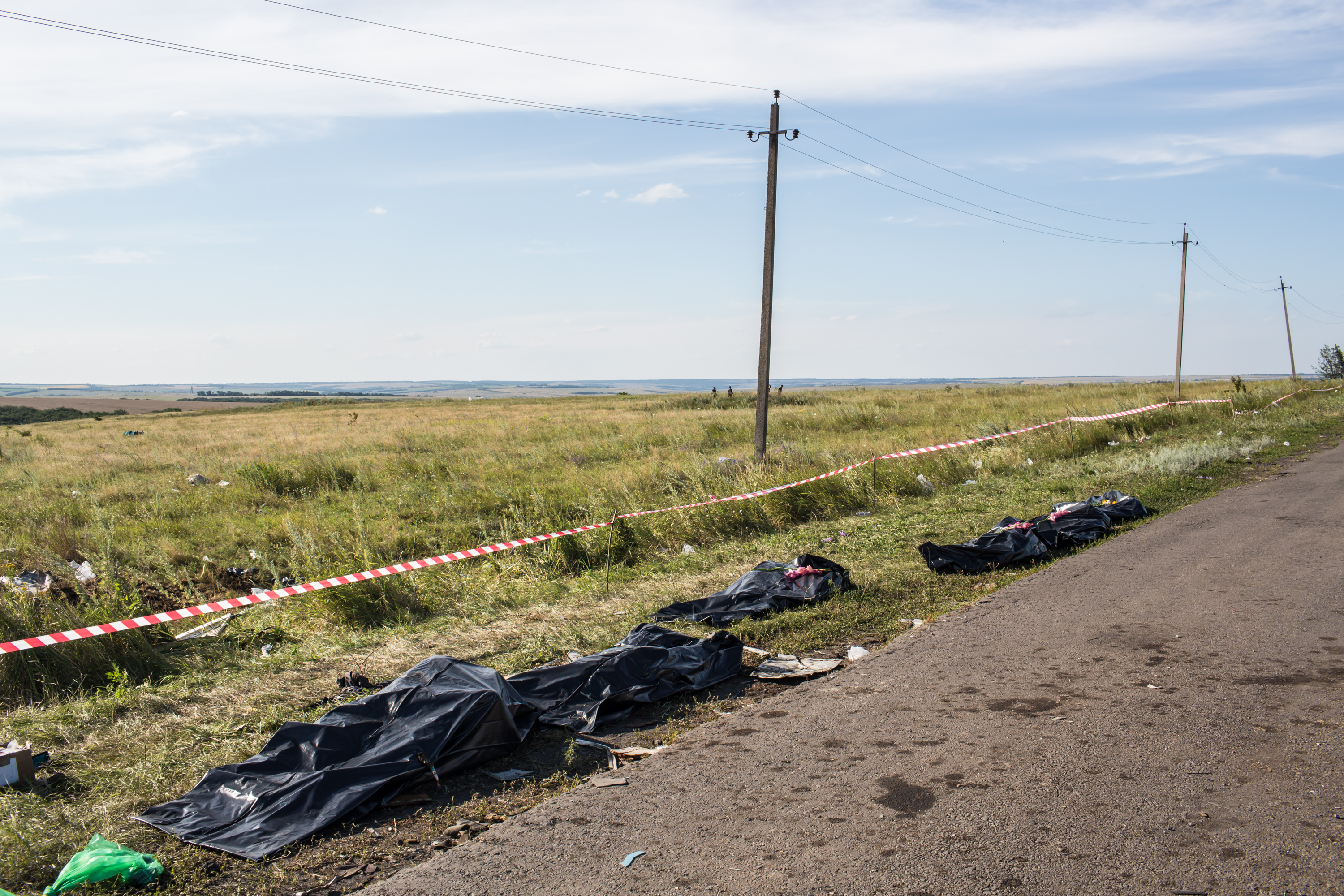 Bodies of those aboard MH17 alongside a road in eastern Ukraine on Sunday.