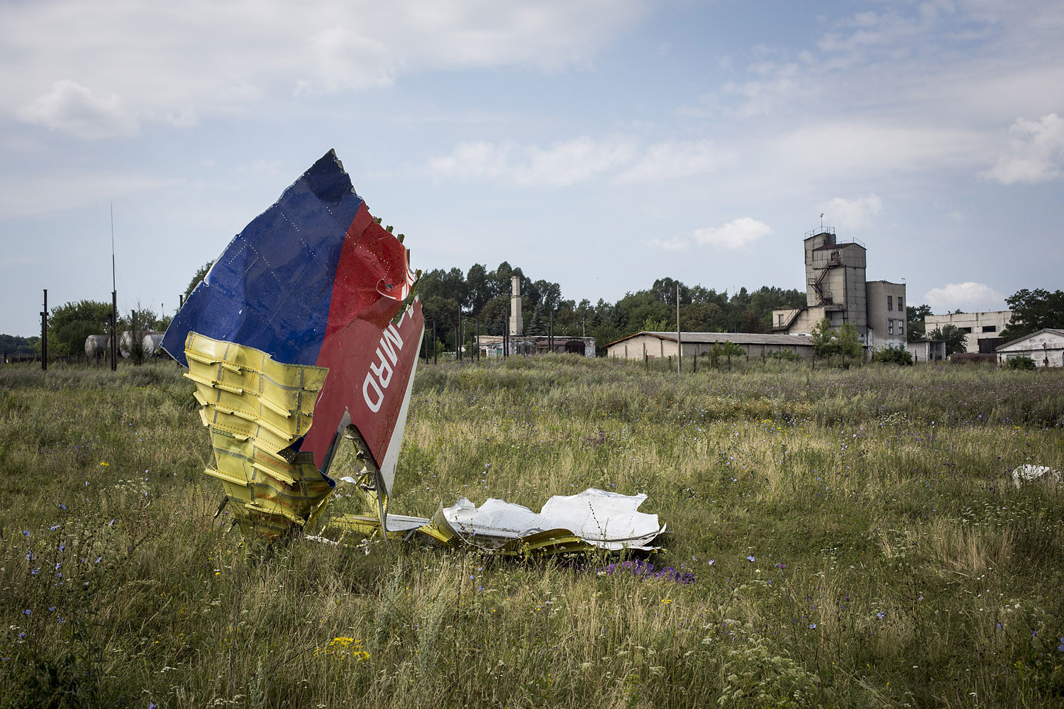 Wreckage from Malaysia Airlines Flight MH17 lies in a field in Grabovo, Ukraine, on July 22, 2014