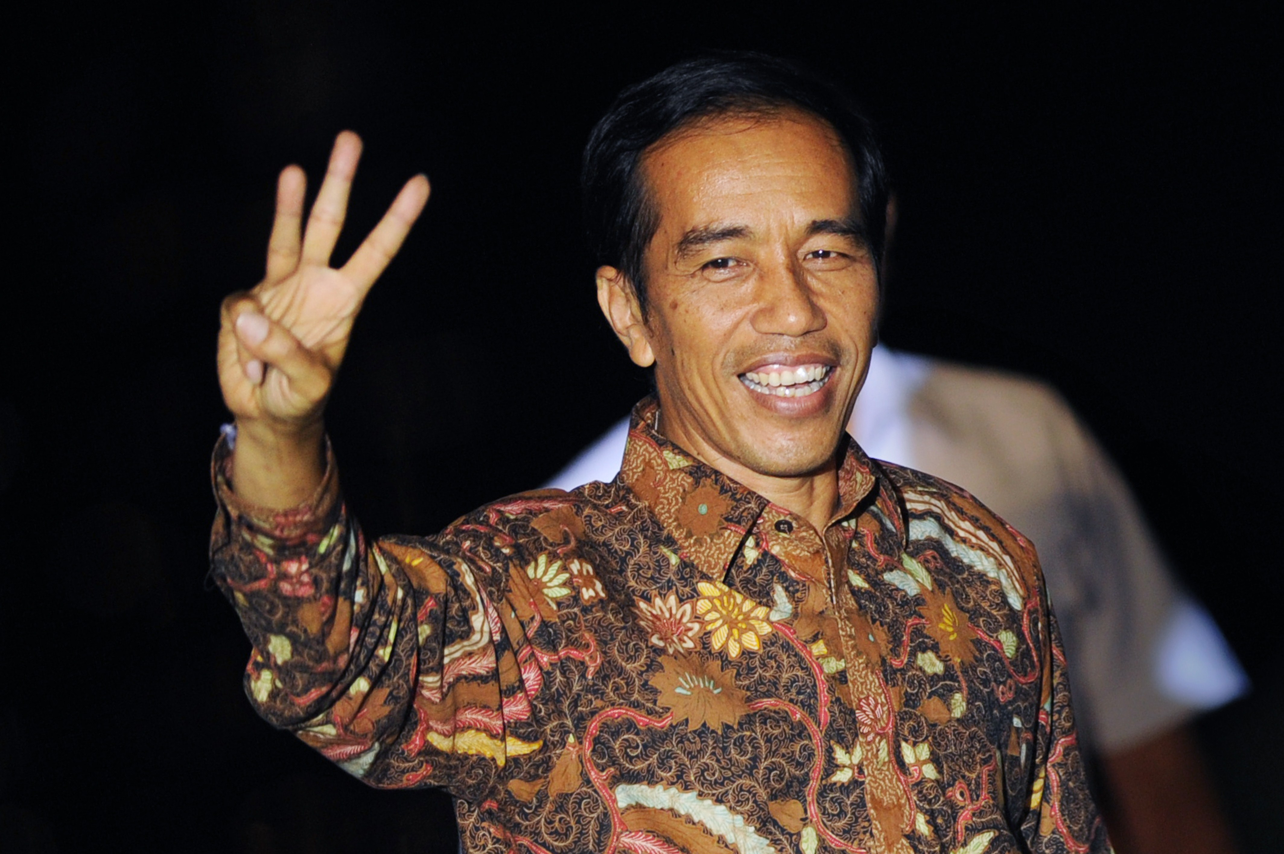 Indonesian President-elect Joko Widodo gestures after delivering his victory address in Jakarta's port district of Sunda Kelapa on July 22, 2014