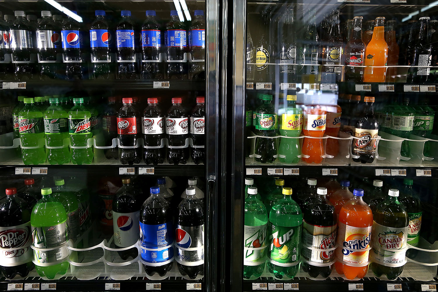 Various bottles of soda are displayed in a cooler at Marina Supermarket on July 22, 2014 in San Francisco.