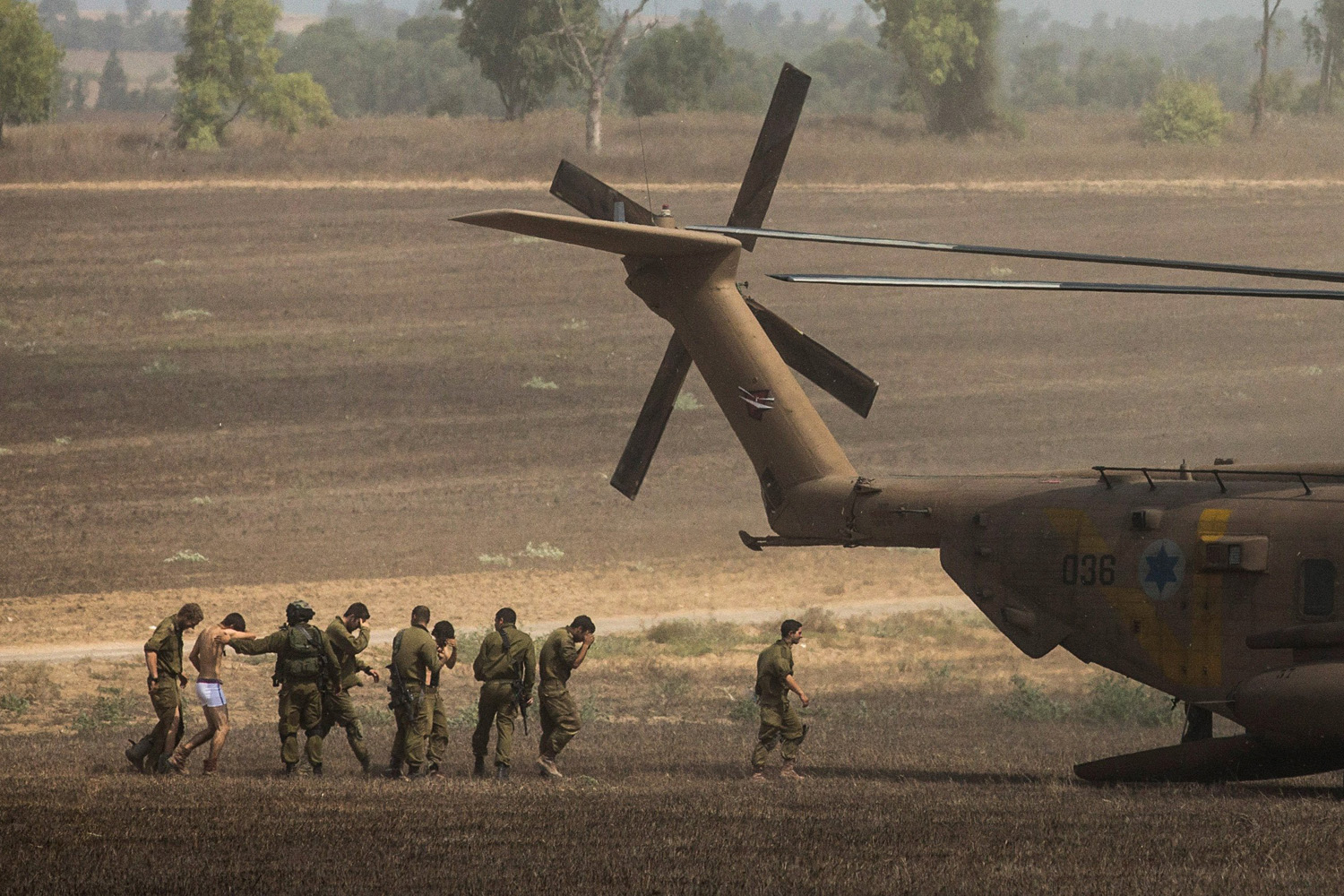 Jul. 23, 2014. Wounded Israeli soldiers are brought to a helicopter near Kafar Aza, Israel. As operation  Protective Edge   enters its 16th day, 29 Israeli soldiers have been killed and over 600 Palestinians have been killed in Gaza.