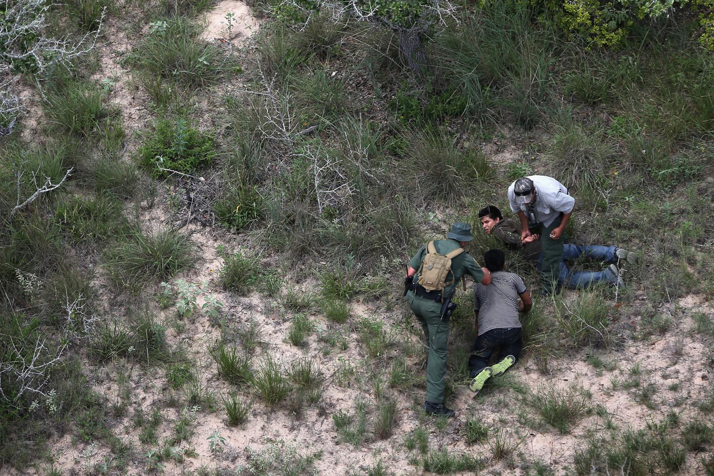 Jul. 23, 2014. U.S. Border Patrol agents detain undocumented immigrants some 60 miles north of the U.S.-Mexico border near Falfurrias, Texas.