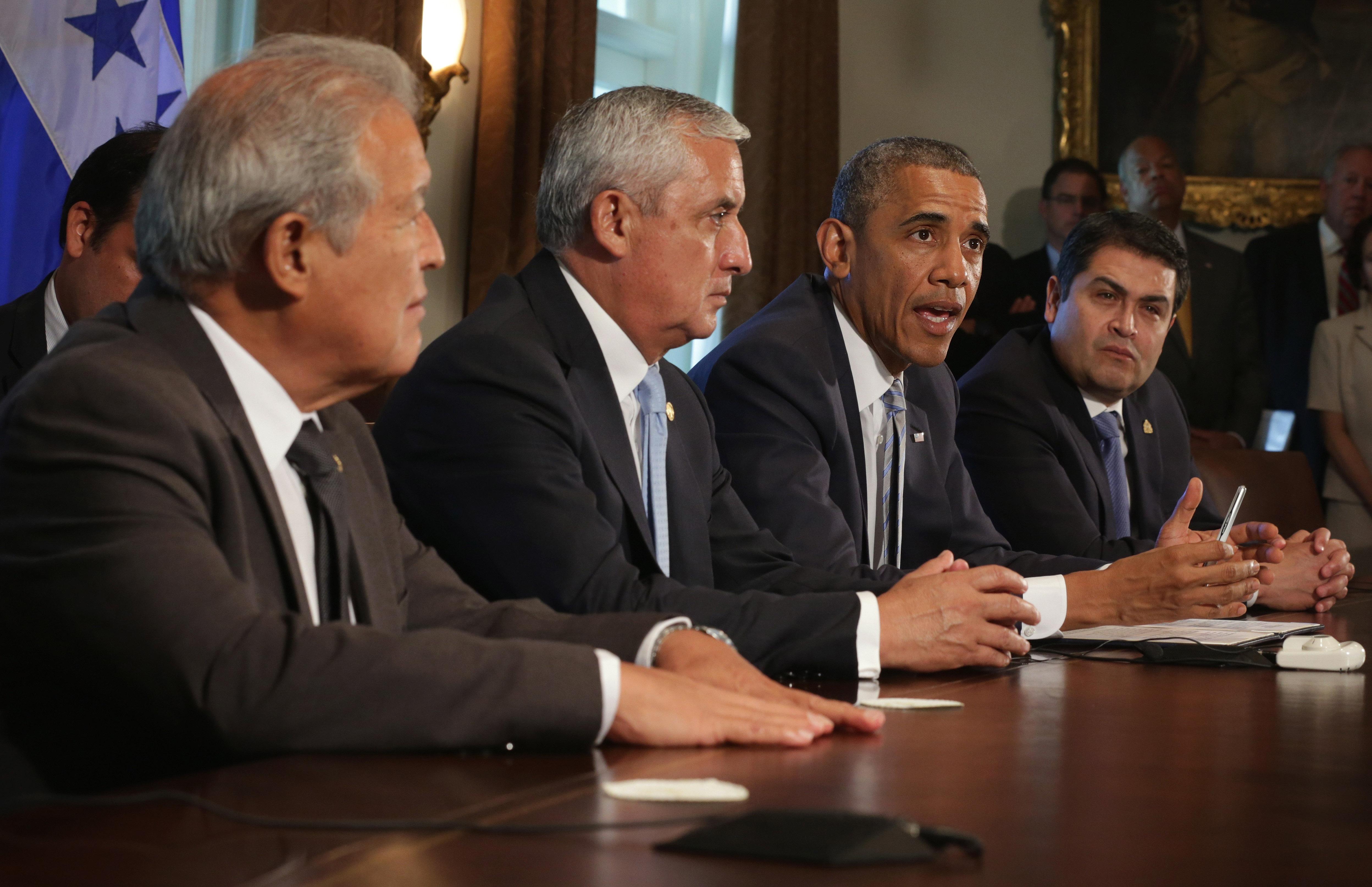 U.S. President Barack Obama speaks as President Otto Perez Molina (2nd L) of Guatemala, President Juan Orlando Hernandez (R) of Honduras, and President Salvador Sanchez Ceren (L) of El Salvador listen in the White House July 25, 2014 in Washington, DC.