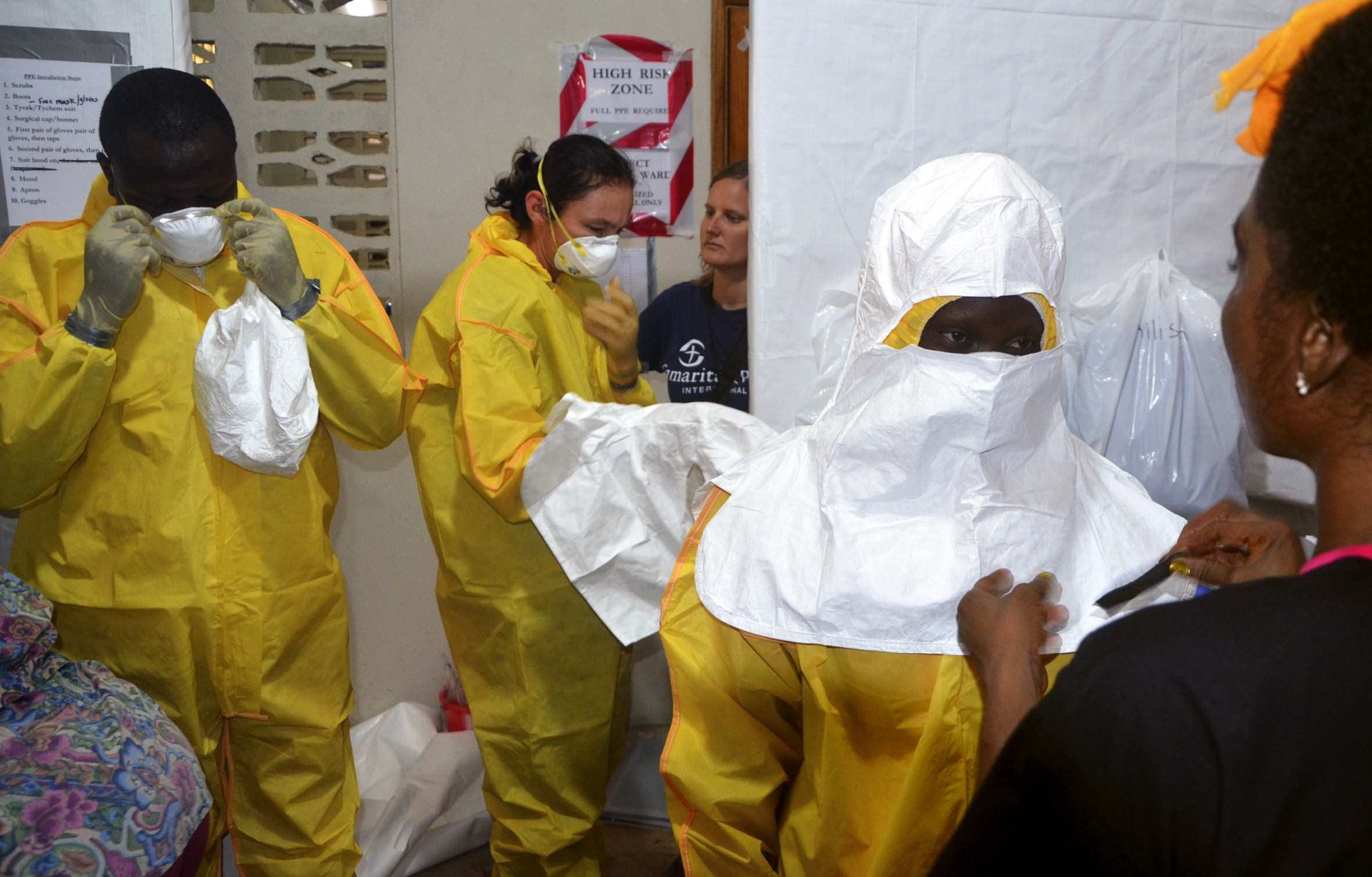 Staff of the Christian charity Samaritan's Purse putting on protective gear in the ELWA Hospital in Monrovia, Liberia, on July 24, 2014