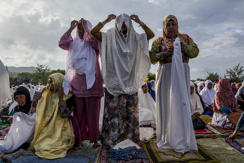 Jul. 28, 2014. Indonesian Muslim women attend Eid Al-Fitr prayer on 'sea of sands' at Parangkusumo beach in Yogyakarta, Indonesia.