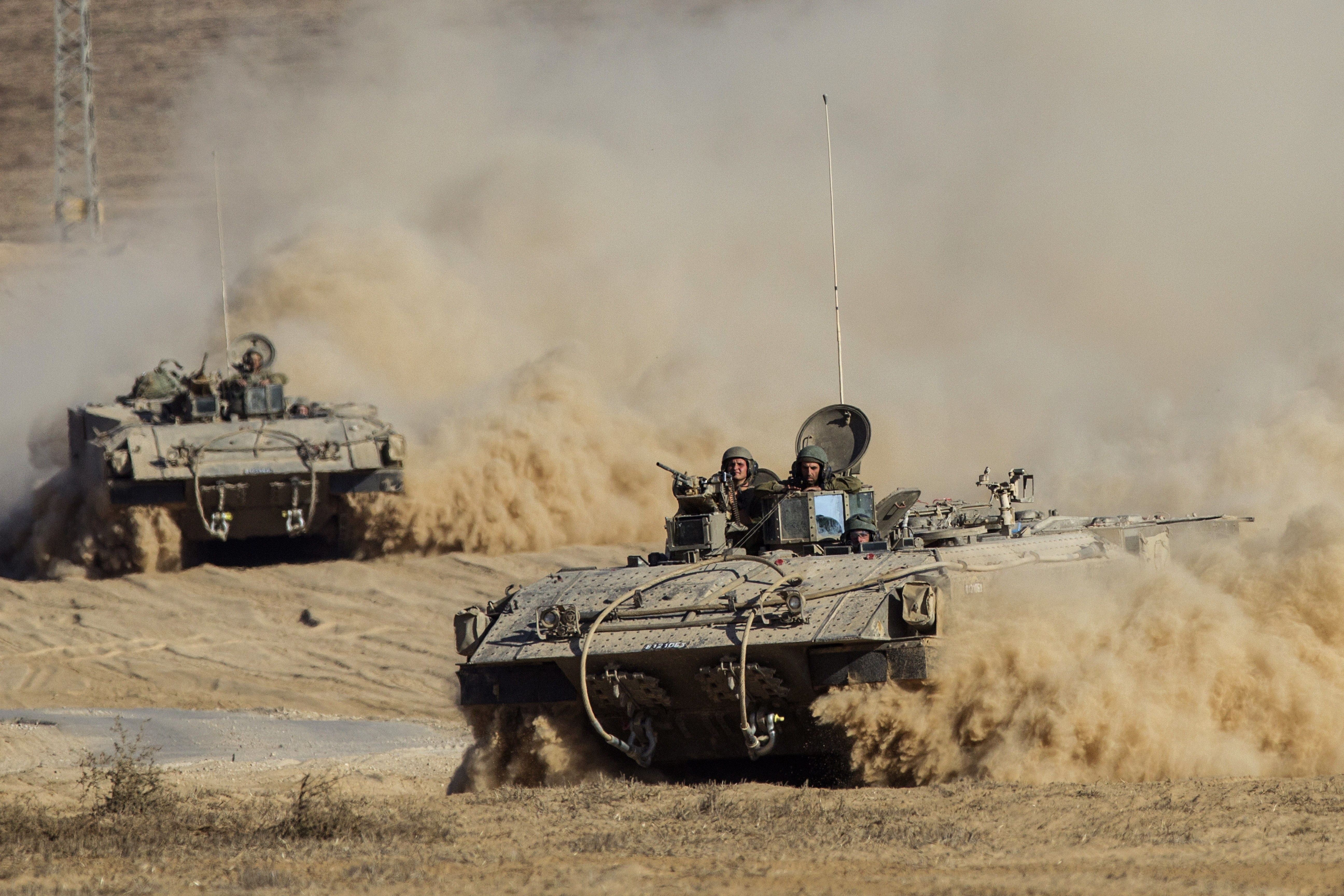 Israeli army armored personnel carriers (APC) move along Israel's border with the Gaza Strip on July 30, 2014.